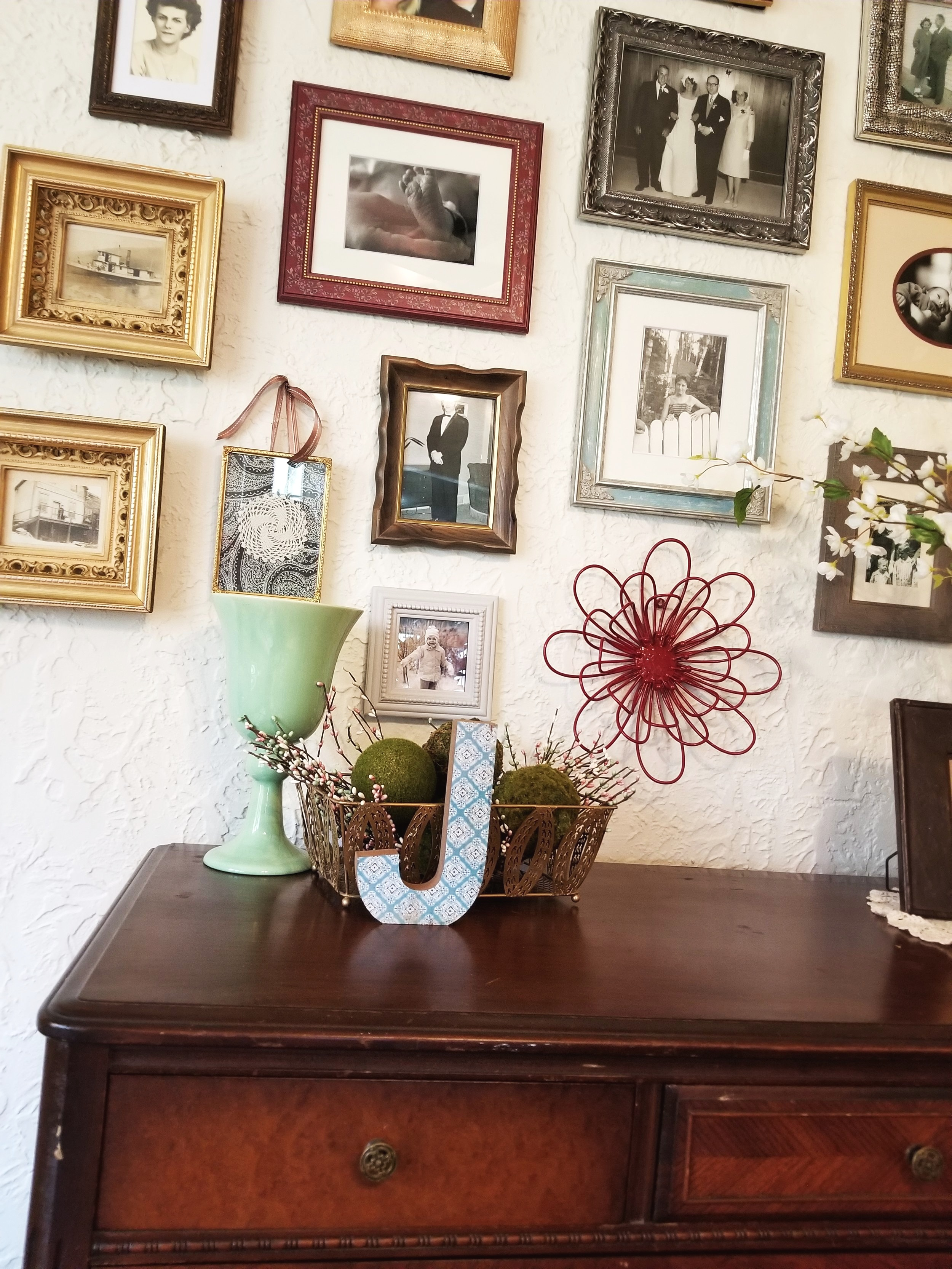 Jen has this great antique buffet just below her gallery. I added a few touches to the buffet surface. It totally to completes the look!