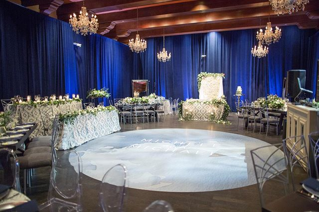 """Blue drape"" I said...""let's do blue drape."" They said ""yes!"" This is that final look and bam....! I like it! Damn...I could do so much more with this space too! Cheers to having rad clients trust the design and vision! Enjoy your weekend y'all! Go do some fun!  Photo by @melissajill design and planning by @lifedesignevents venue @omnimonteluciaweddings #lifedesignevents"