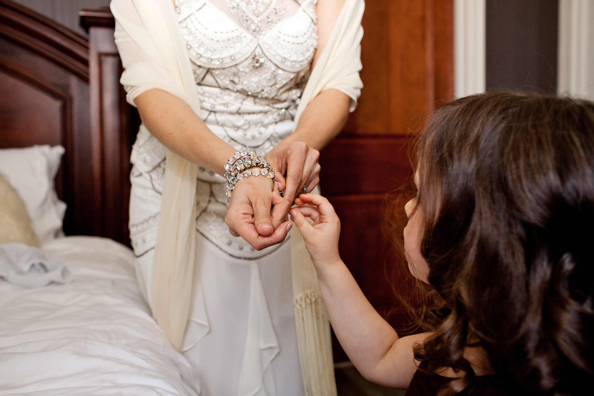 4 bride getting ready bride putting on dress unique wedding dress off white wedding dress detailed wedding dress Life Design Events.jpg