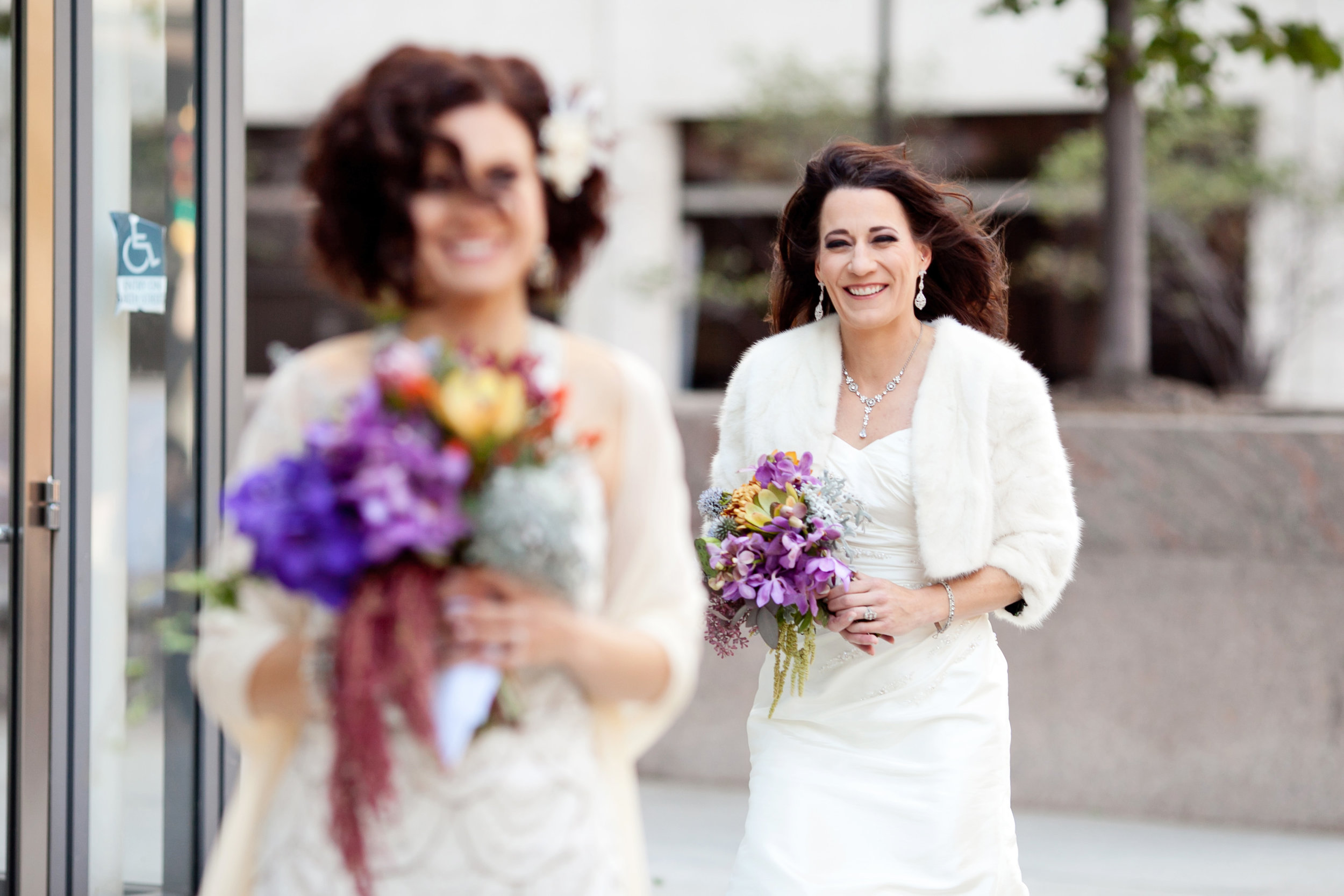 9 first look two brides two brides first look colorful bouquets both brides wear wedding dresses candid first look moment Life Design Events.jpg