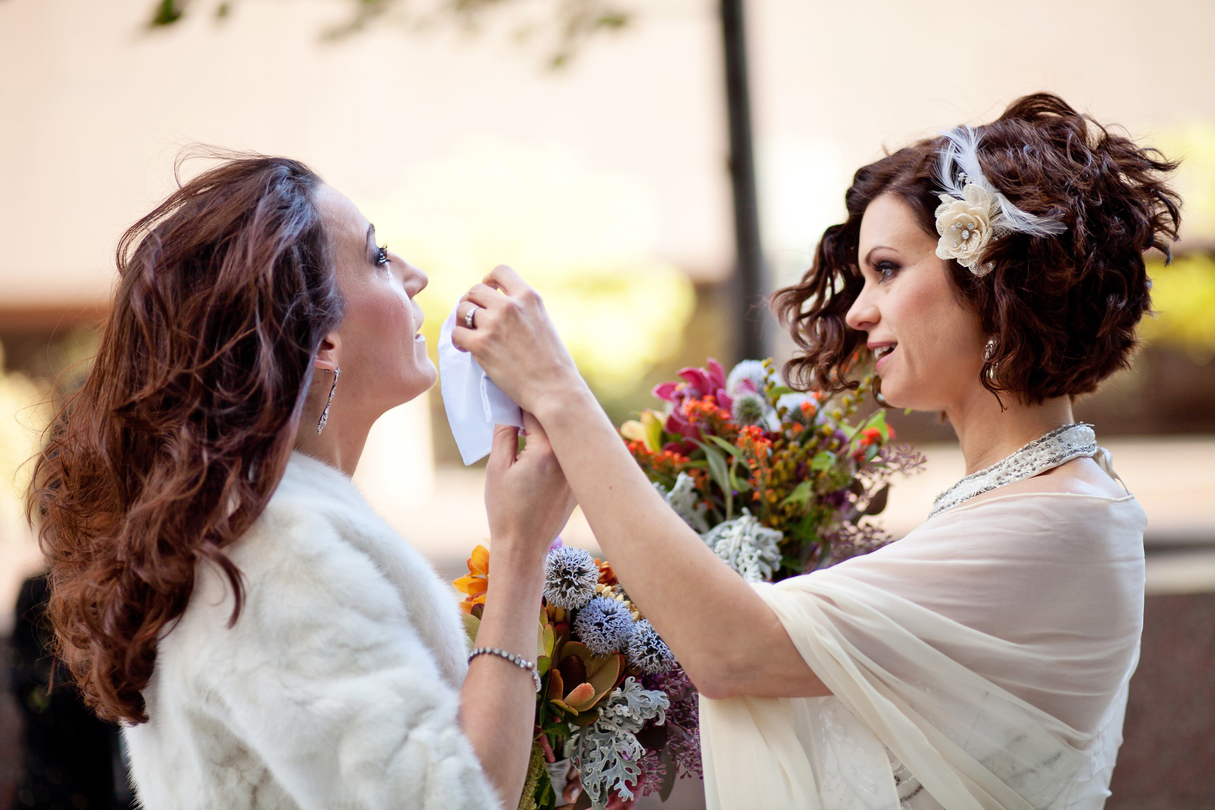 11 first look two brides two brides first look colorful bouquets both brides wear wedding dresses candid first look moment Life Design Events.jpg
