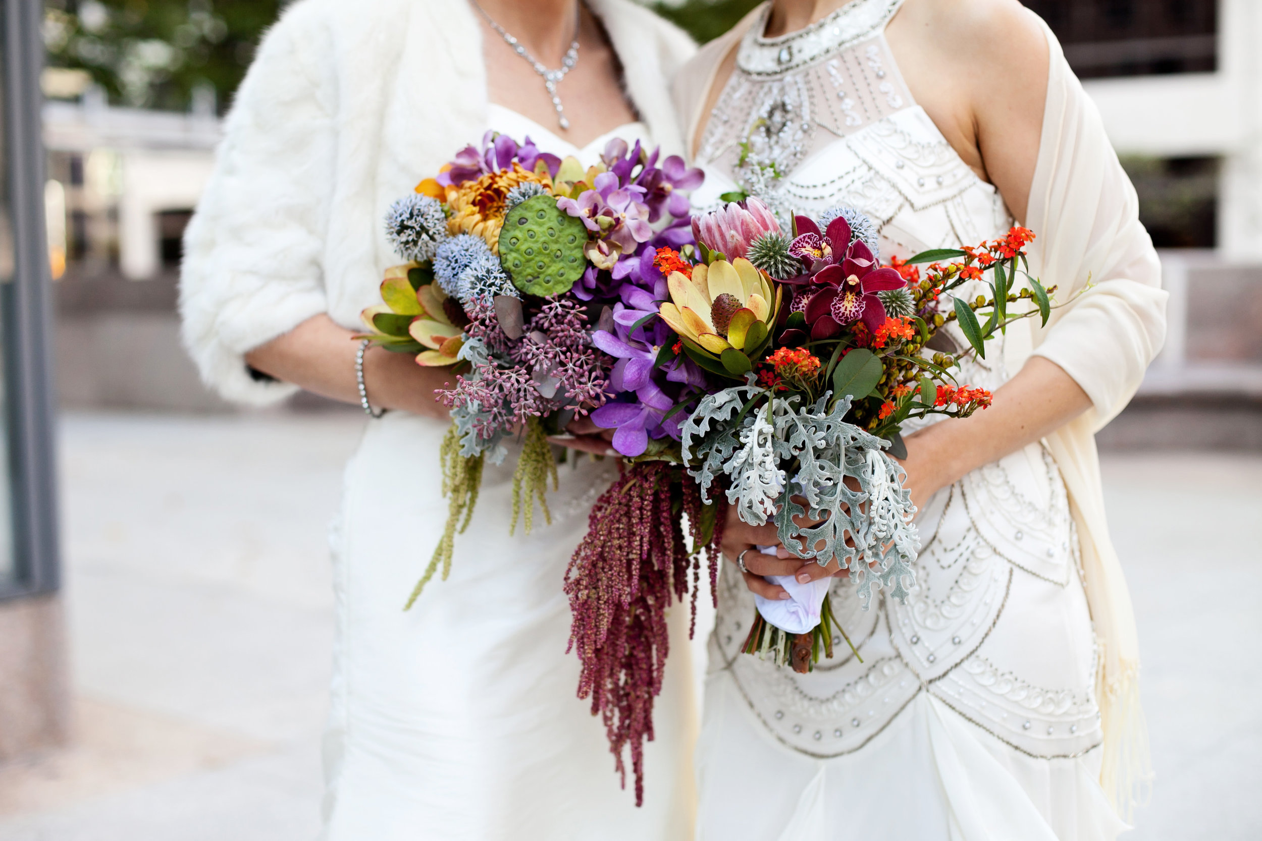 13 first look two brides two brides first look colorful bouquets both brides wear wedding dresses candid first look moment Life Design Events.jpg