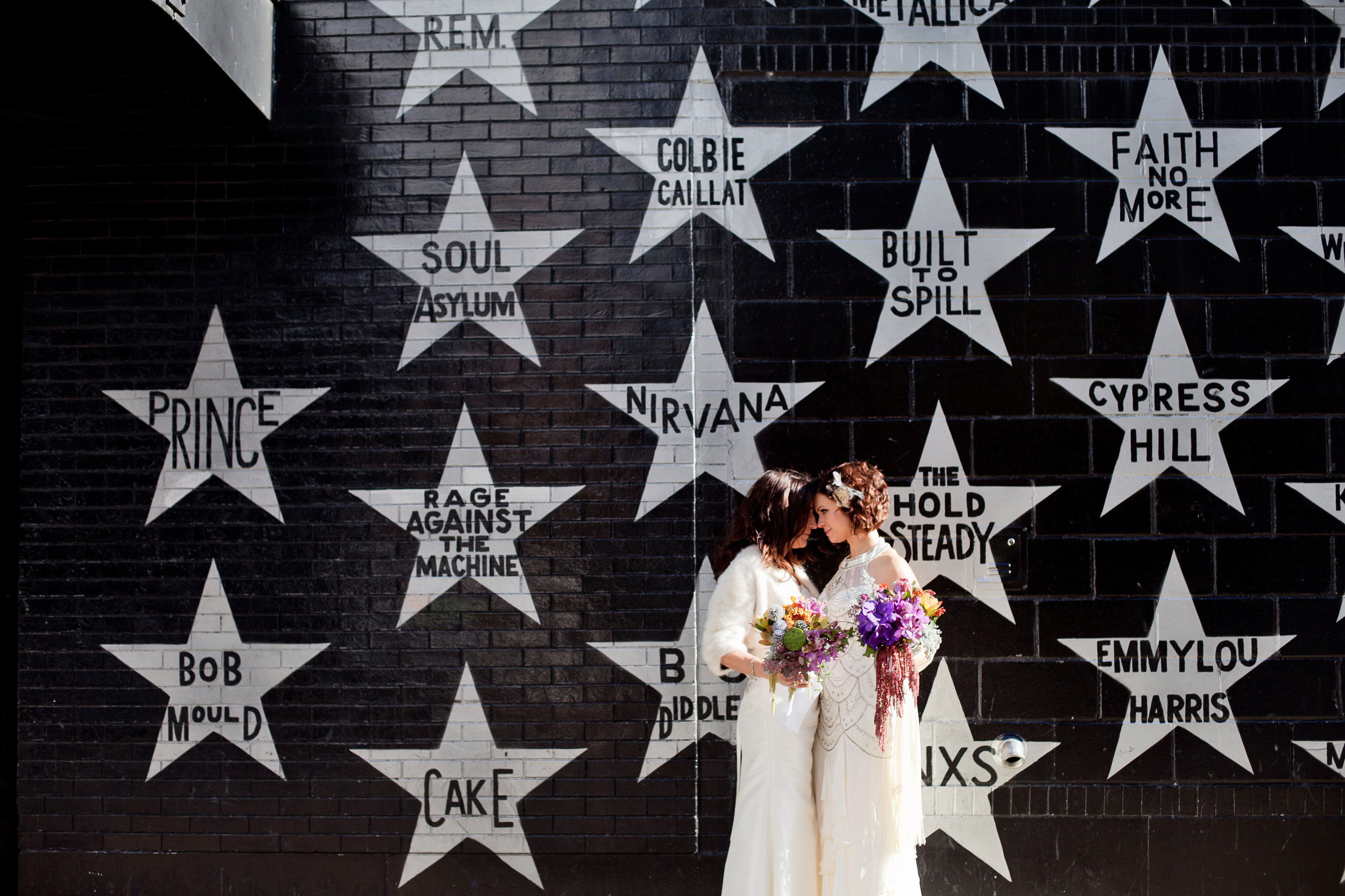 16 two brides star wall music wall unique wedding back drops candid first look shots Life Design Events .jpg