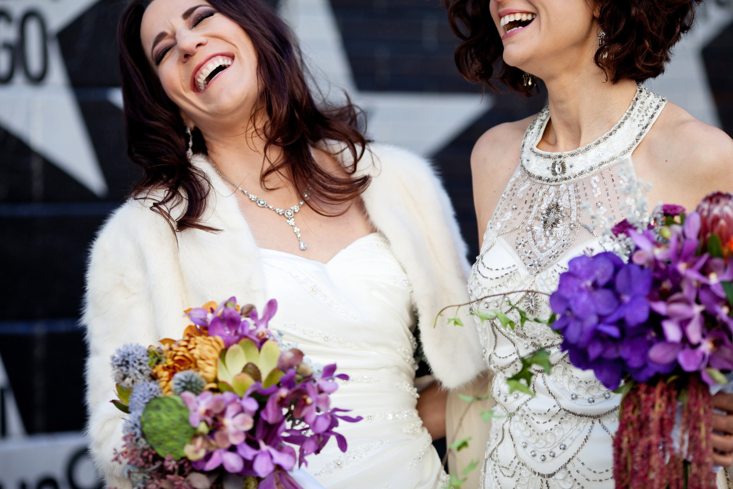 18  first look two brides two brides first look colorful bouquets both brides wear wedding dresses candid first look moment Life Design Events.jpg
