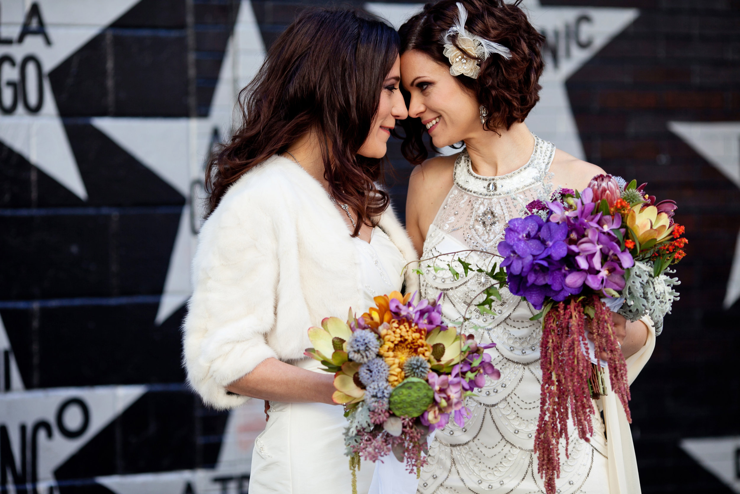 19  first look two brides two brides first look colorful bouquets both brides wear wedding dresses candid first look moment Life Design Events.jpg