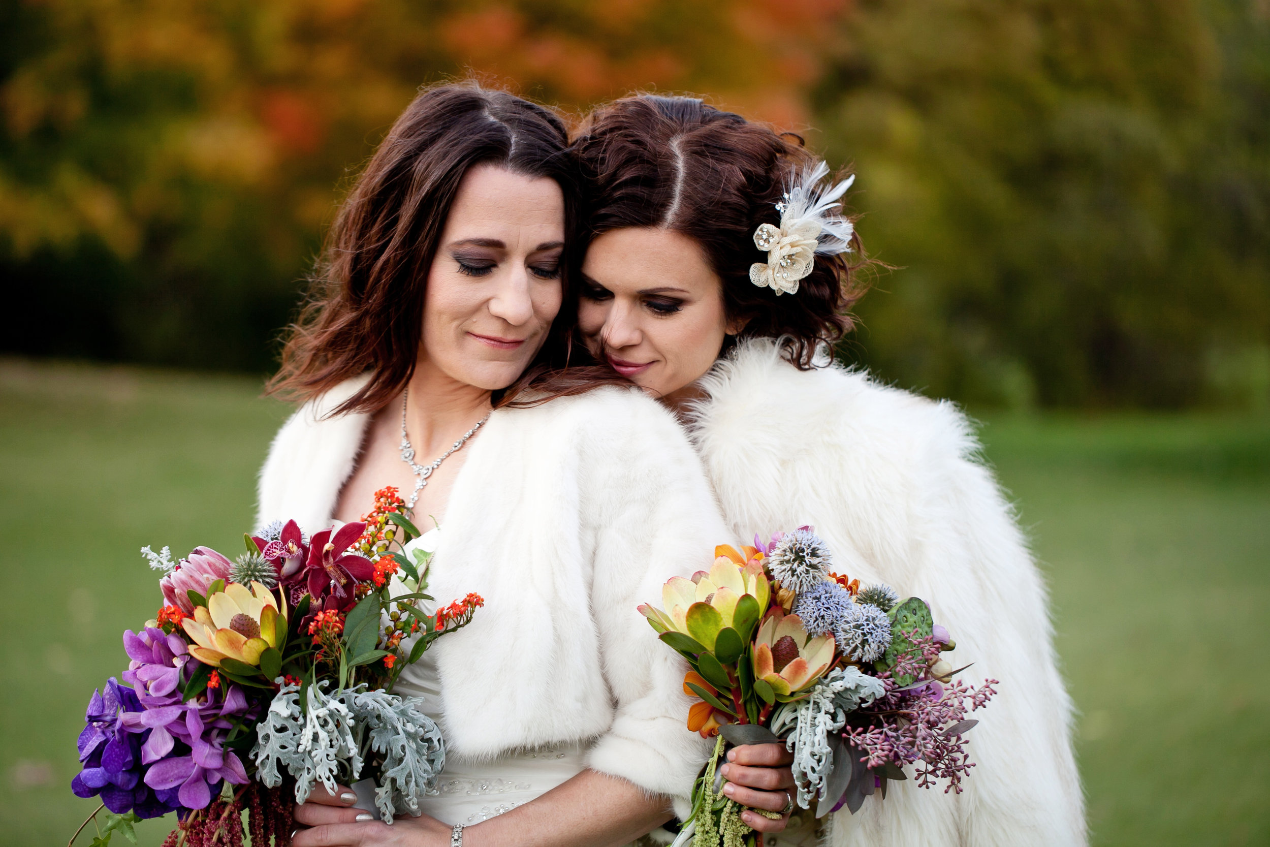 36 two brides two brides poses candid wedding shots brides with fur coats colorful bouquets spring bouquets Life Design Events.jpg