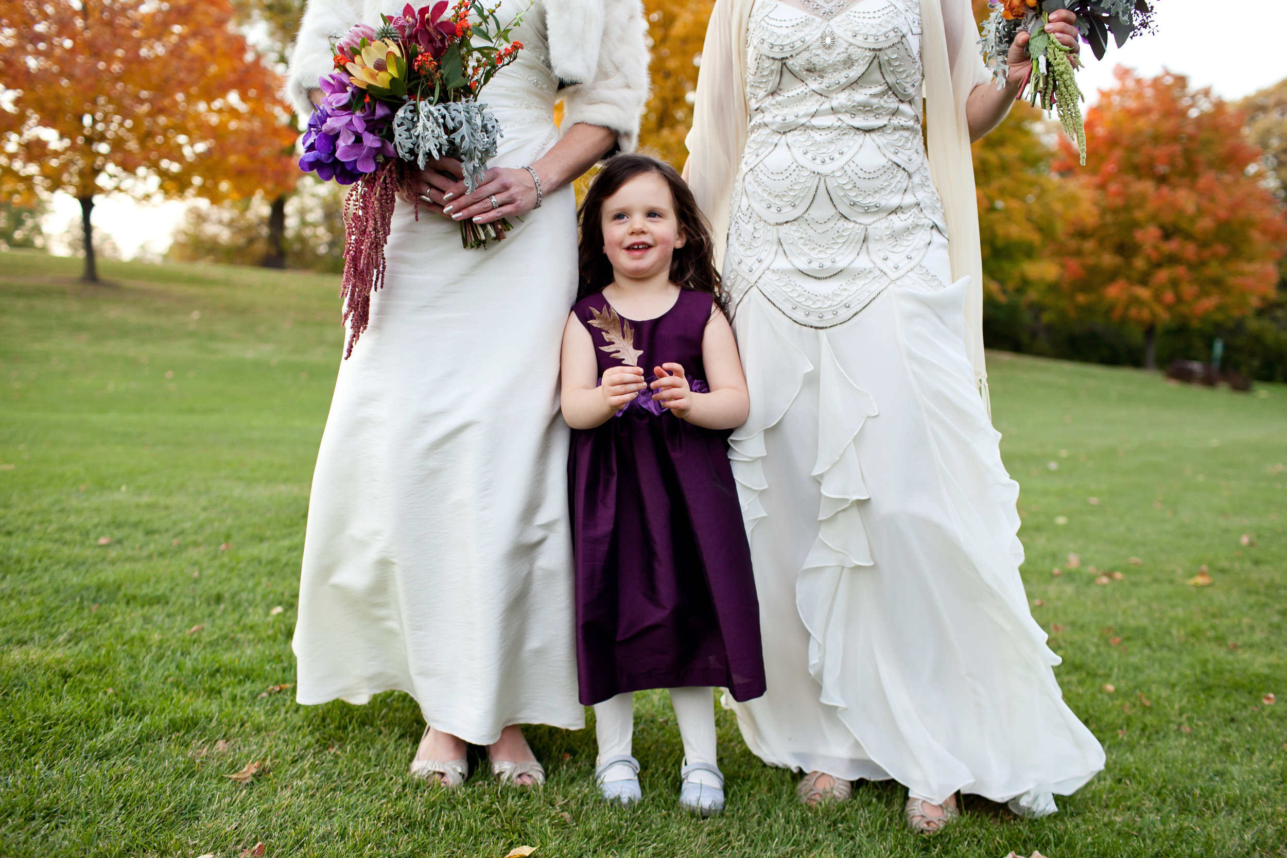 37 bride and flower girl two brides with flower girl candid wedding photos purple flower girl dress Life Design Events.jpg