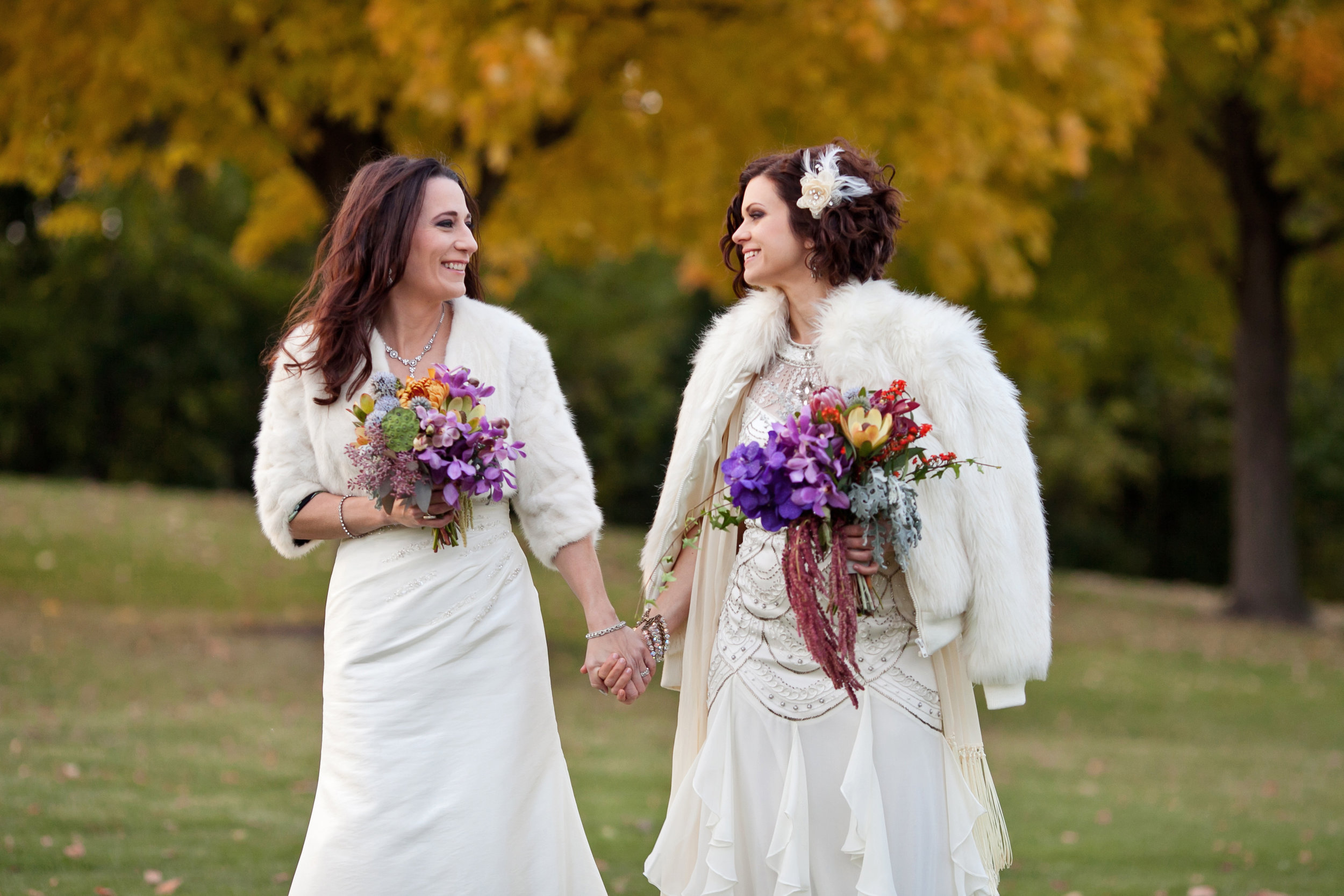 39 two brides two brides poses candid wedding shots brides with fur coats colorful bouquets spring bouquets Life Design Events.jpg