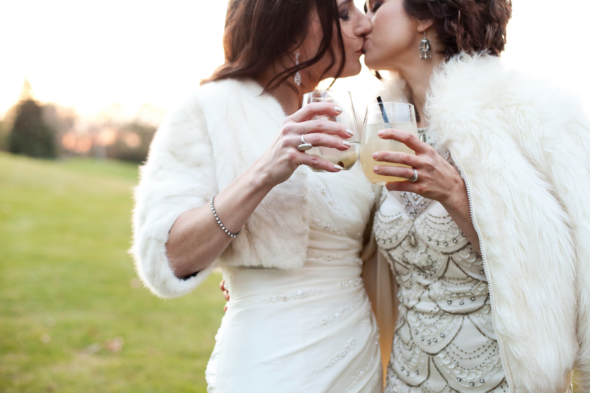 41  two brides two brides poses candid wedding shots brides with fur coats colorful bouquets spring bouquets brides kissing Life Design Events.jpg