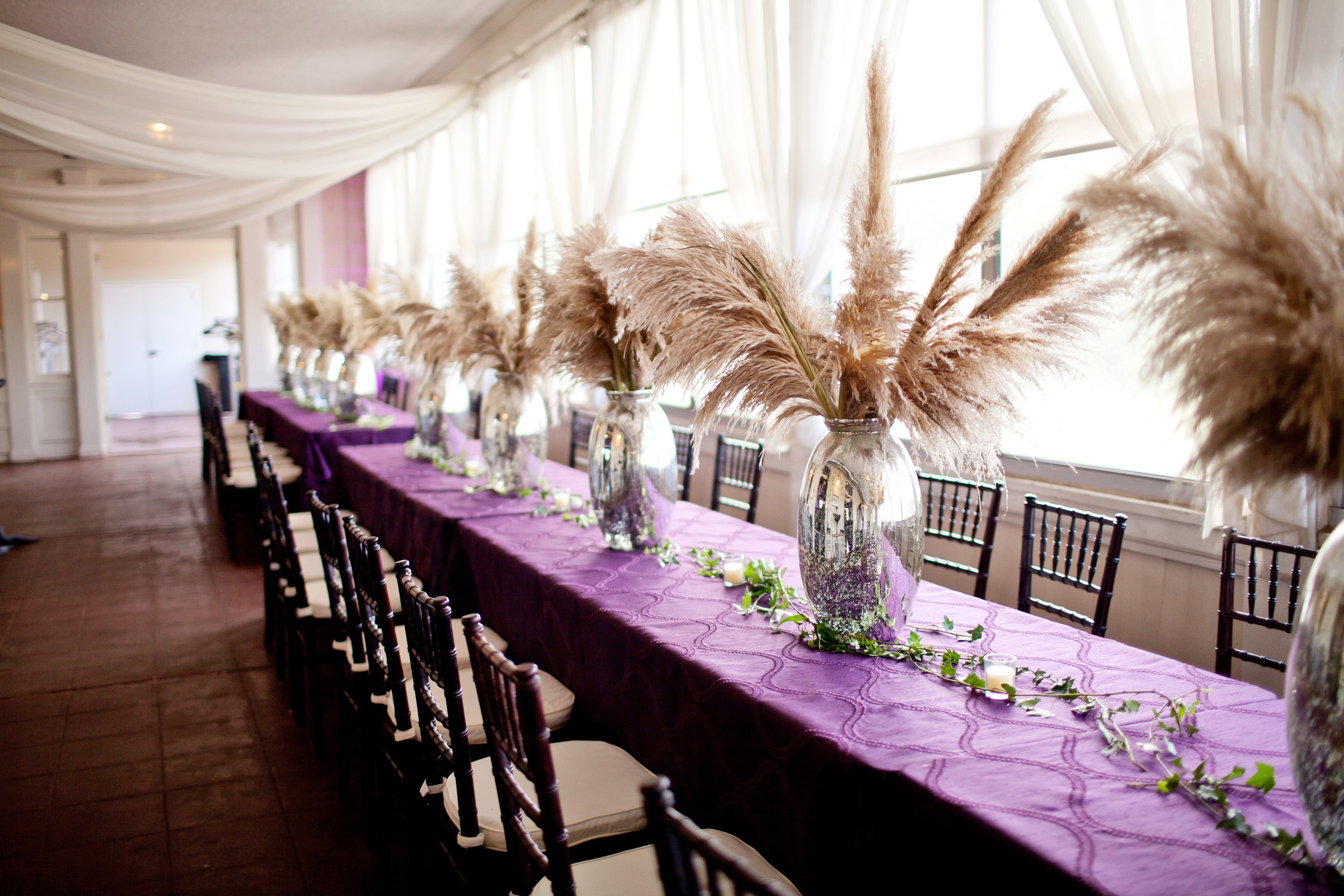 45 unique wedding decor large centerpieces pampas grass centerpieces purple and white wedding purple table cloths silver vases with pampas grass Life Design Events .jpg