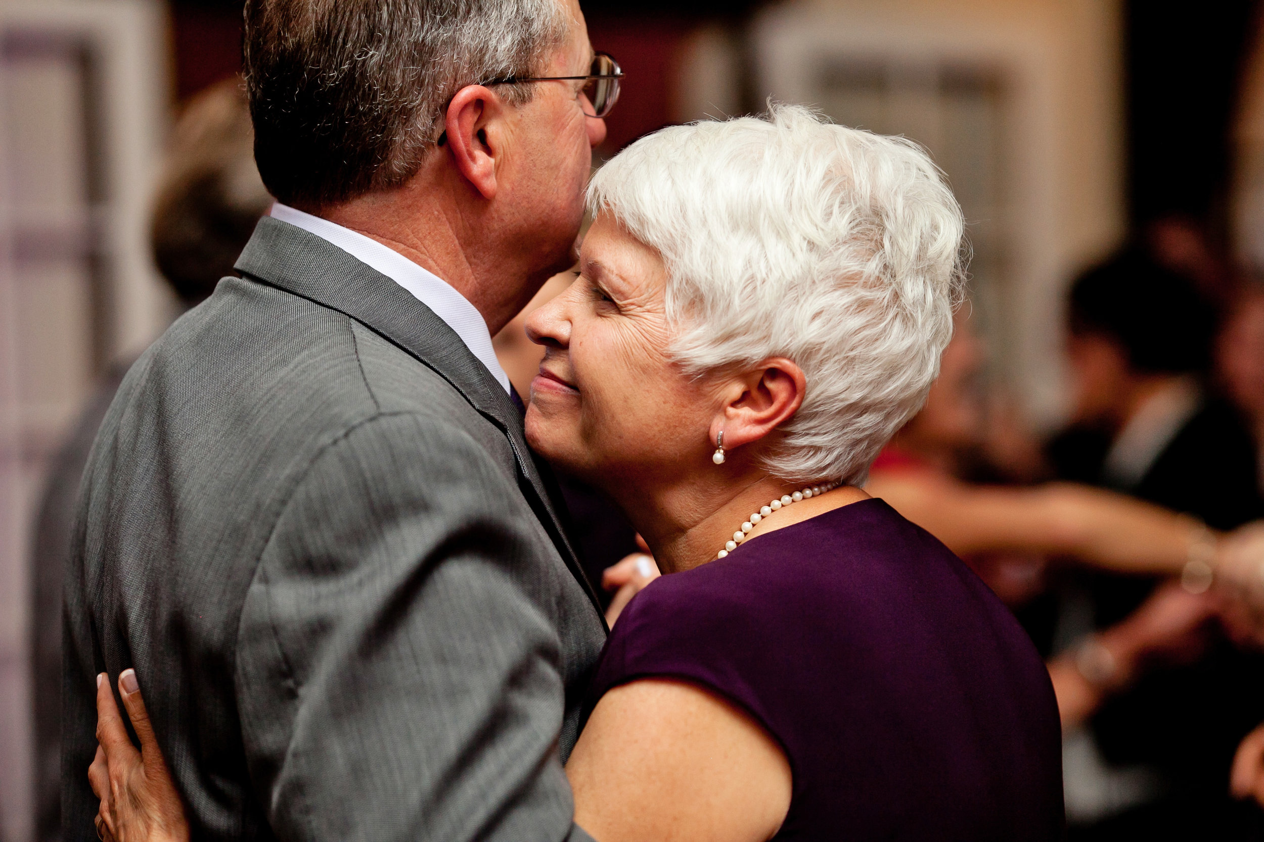 55 mother and father of the bride candid reception photos mother and father of bride dancing Life Design Events .jpg