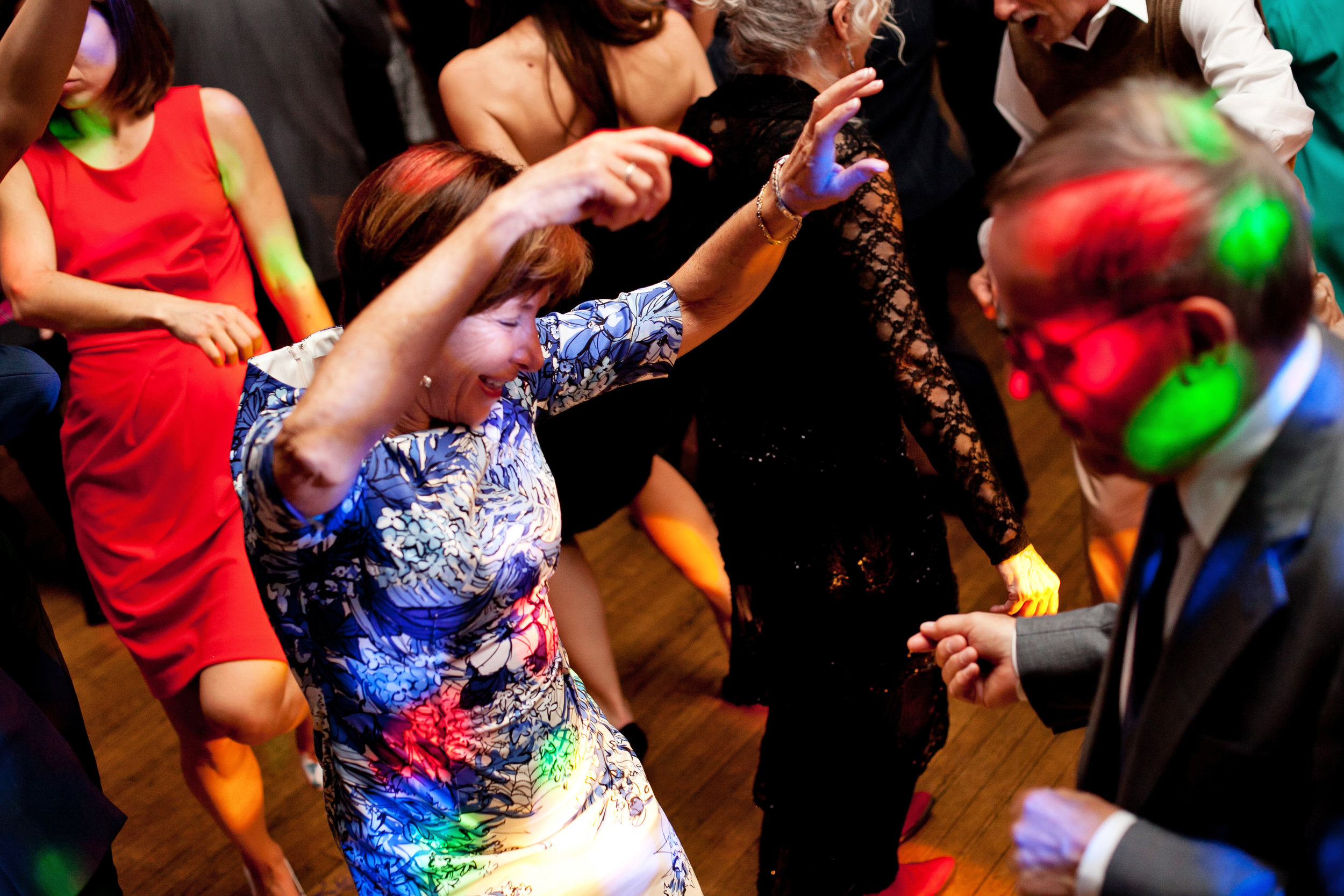 56 dance floor fun at reception guest dancing at wedding candid reception moments disco ball at reception Life Design Events.jpg