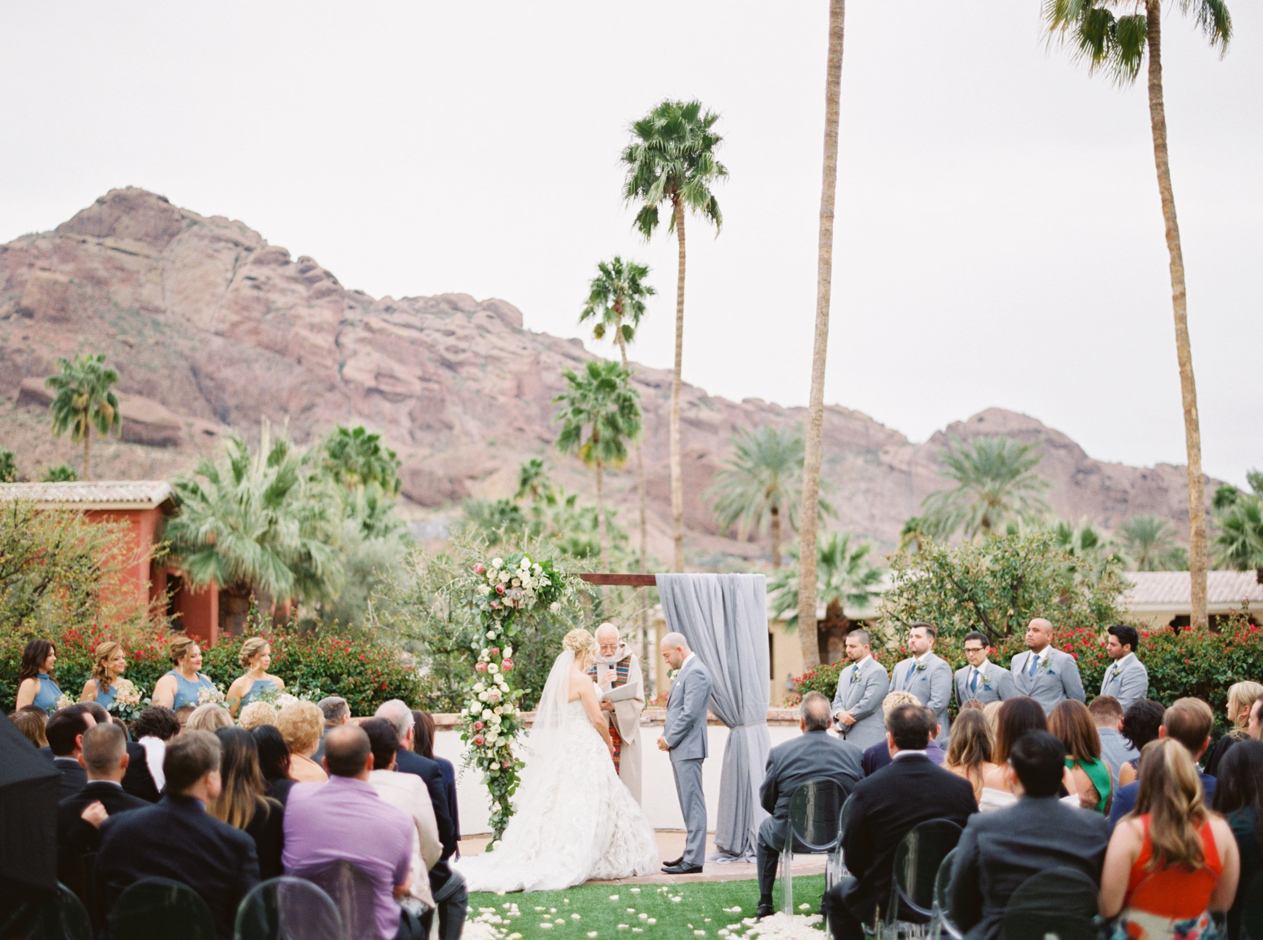 30 bride groom wedding ceremony outdoor wedding rain on wedding day camelback mountain view omni scottsdale montelucia wedding ceremony prayer Life Design Events photos by Melissa Jill Photography.jpg