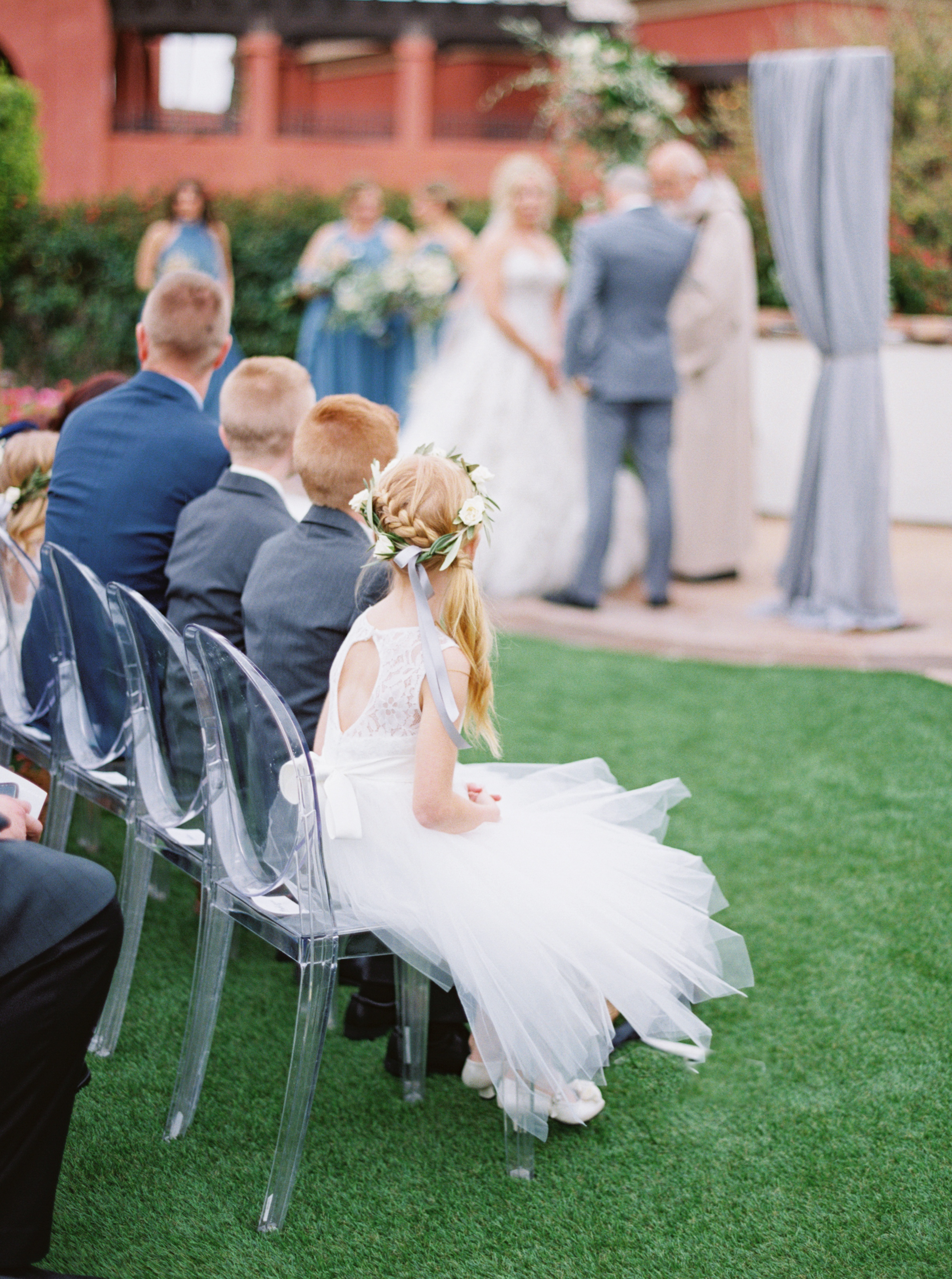 31 flower girl ring bearer watch ceremony bride groom exchange vows outdoor wedding rain on wedding day Life Design Events photos by Melissa Jill Photography.jpg
