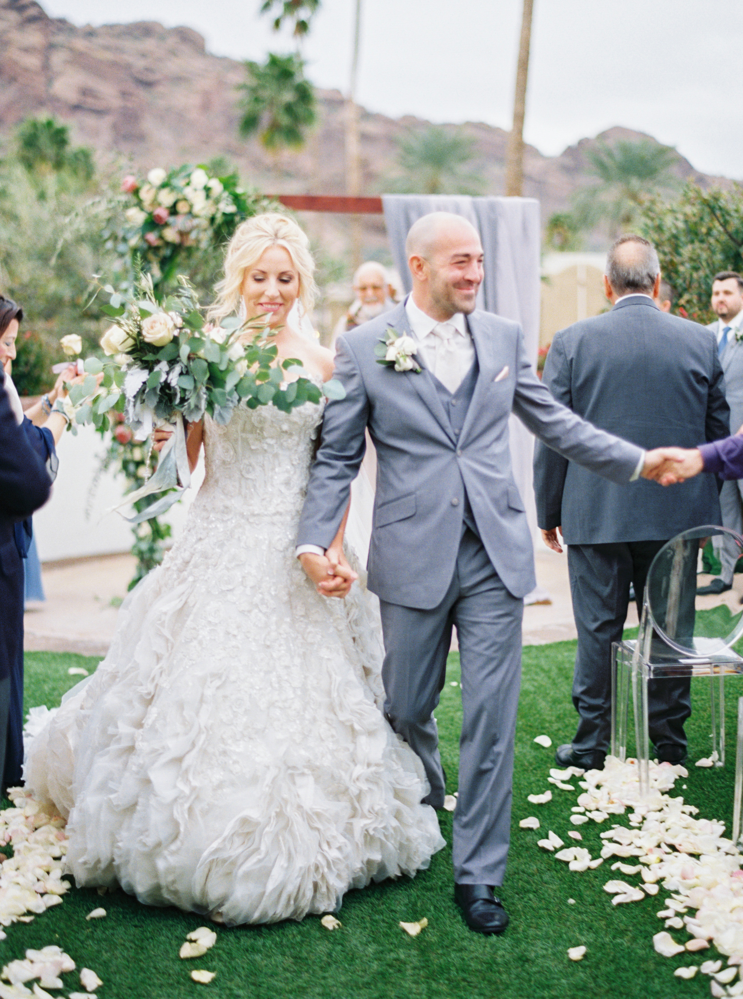34 bride groom married leave ceremony bride groom excited walk down aisle happy couple flower aisle outdoor wedding designer wedding dress Life Design Events photos by Melissa Jill Photography.jpg