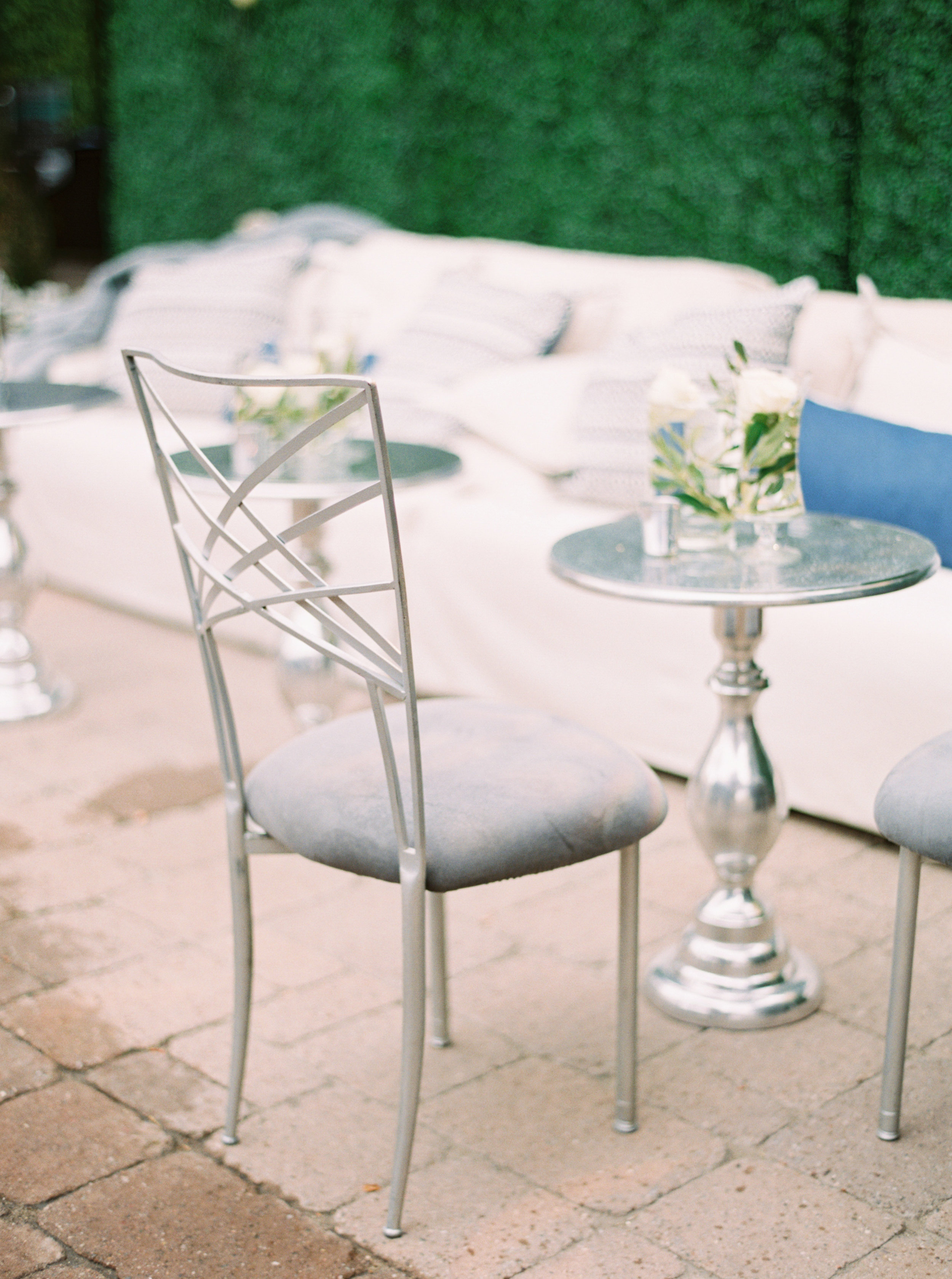 35 cocktail hour cocktail seating soft seating couch cocktail hour chameleon silver chair simple wedding centerpiece Life Design Events photos by Melissa Jill Photography.jpg