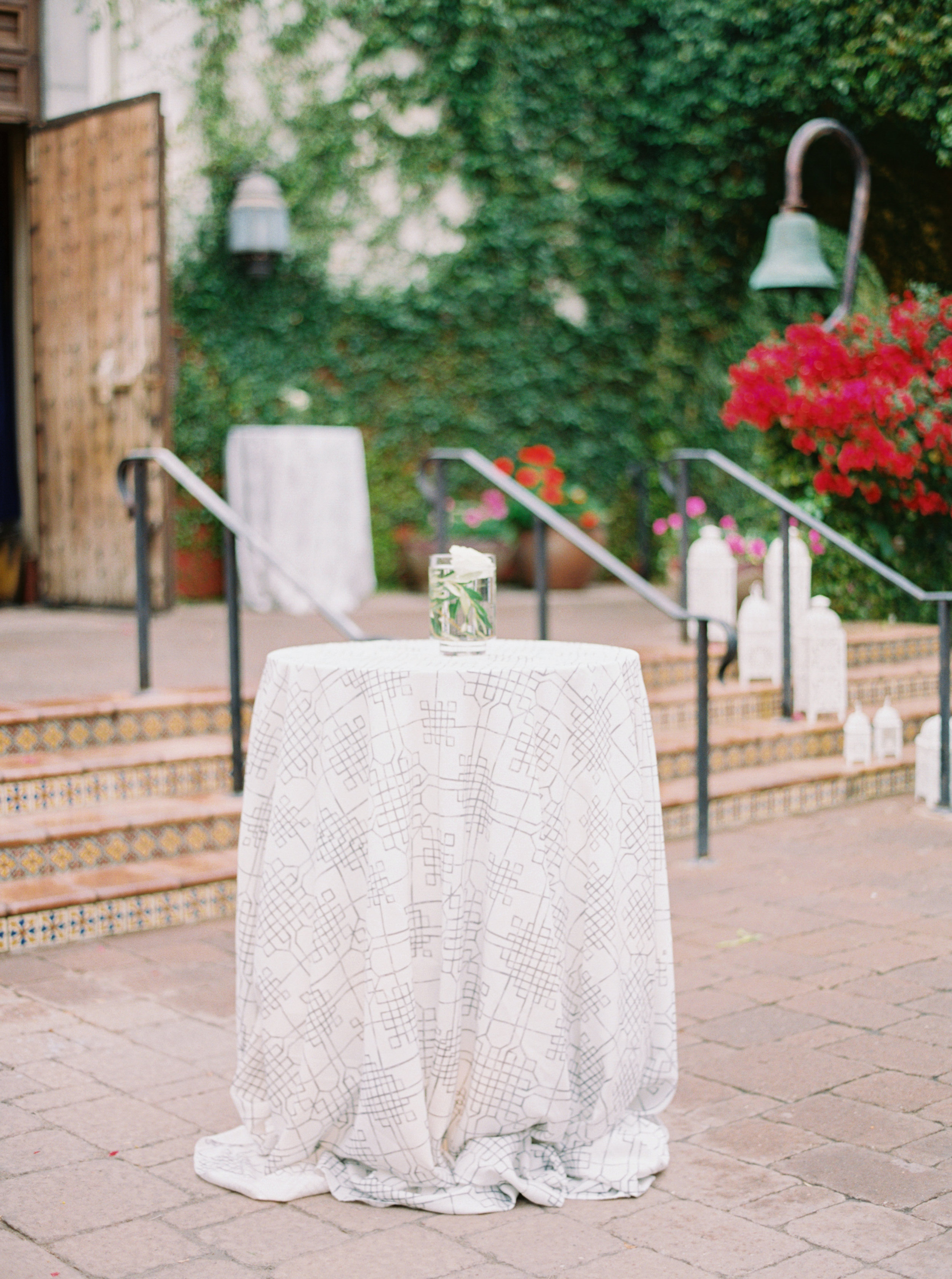 37 cocktail hour cocktail table soft color palette grey blue wedding color simple wedding centerpiece Life Design Events photos by Melissa Jill Photography.jpg