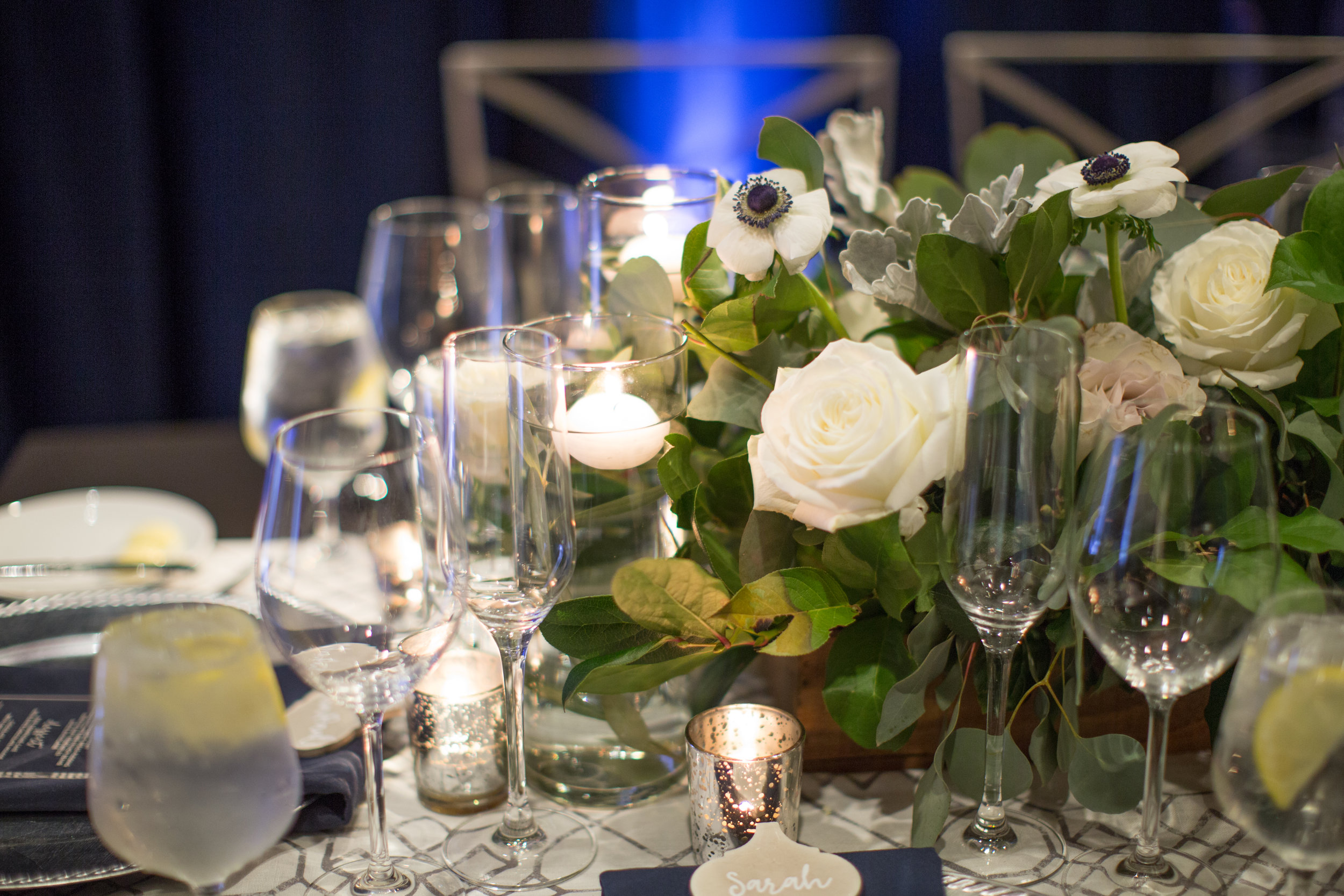 48 white flower centerpiece rose black white poppy white flower black center candlelight dinner wedding guest table Life Design Events photos by Melissa Jill Photography.jpg