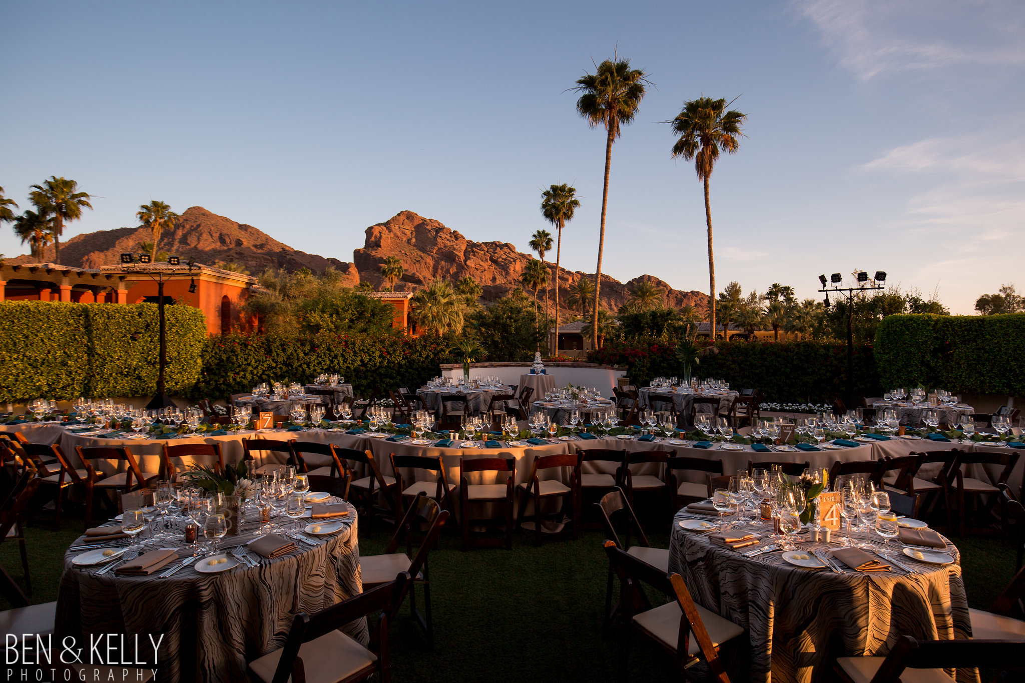 27 wedding reception table serpentine table unique wedding reception set up backyard wedding dinner camelback mountain wedding omni scottsdale montelucia wedding dinner reception sunset wedding Life Design Events photo by Ben and Kelly Photography.jpg