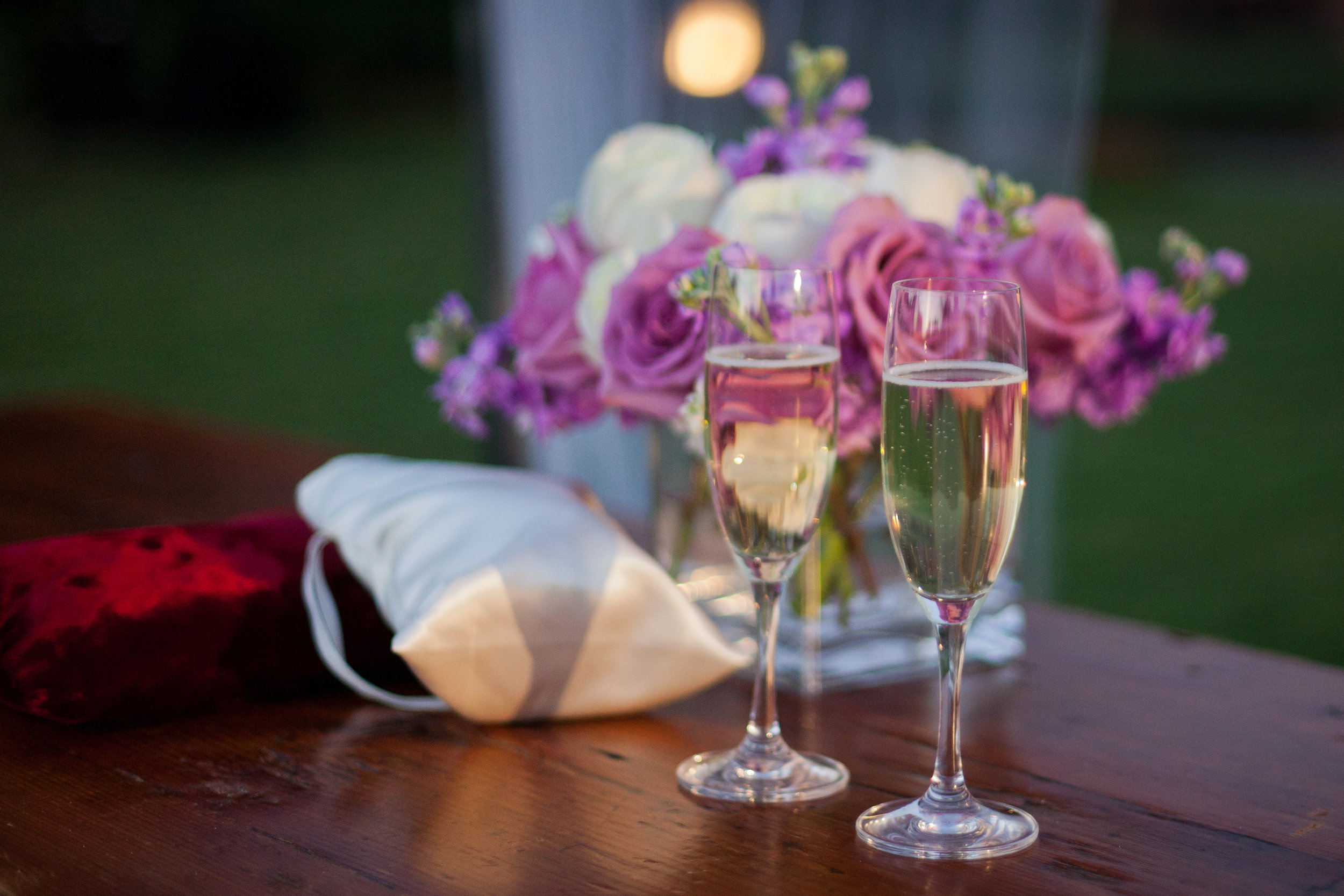 12 champagne to toast with champagne glasses purple and white rose centerpieces Sergio Photography Life Design Events.JPG