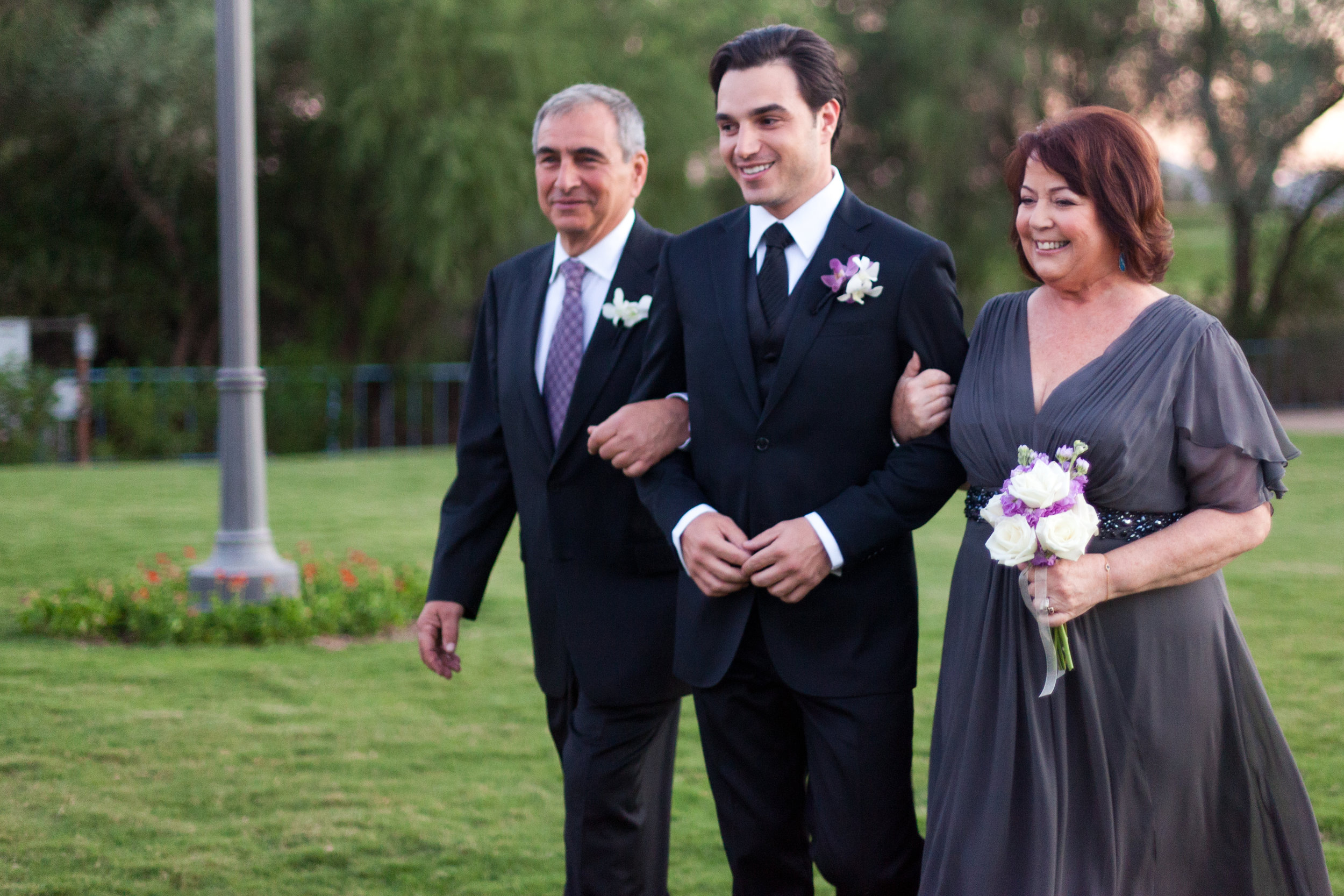 14 groom with parents groom walking down aisle with his parents outdoor ceremony Sergio Photography Life Design Events.JPG