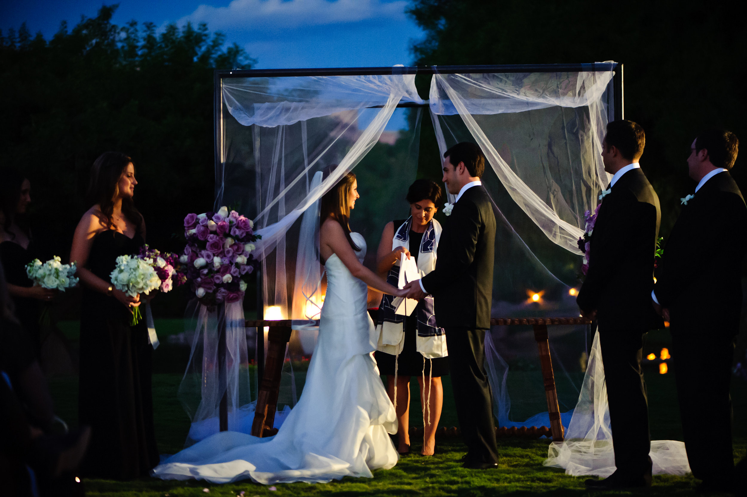 20 bride and groom at the alter evening wedding ceremony bride and groom exchanging vows Sergio Photography Life Design Events.JPG
