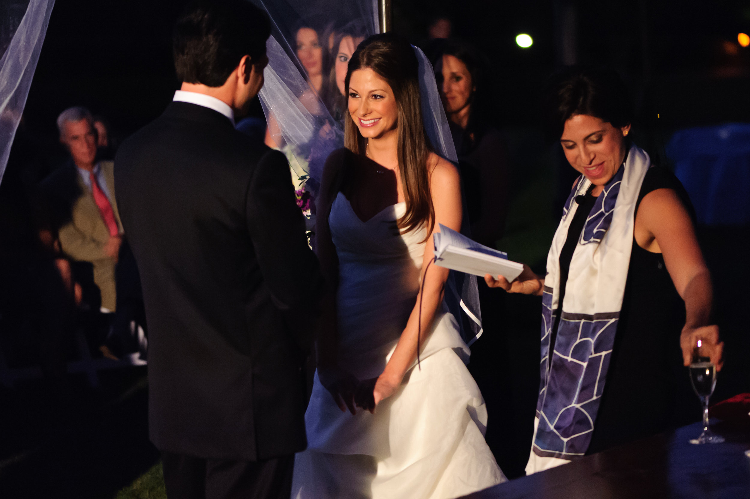 21  bride and groom at the alter evening wedding ceremony bride and groom exchanging vows Sergio Photography Life Design Events.JPG