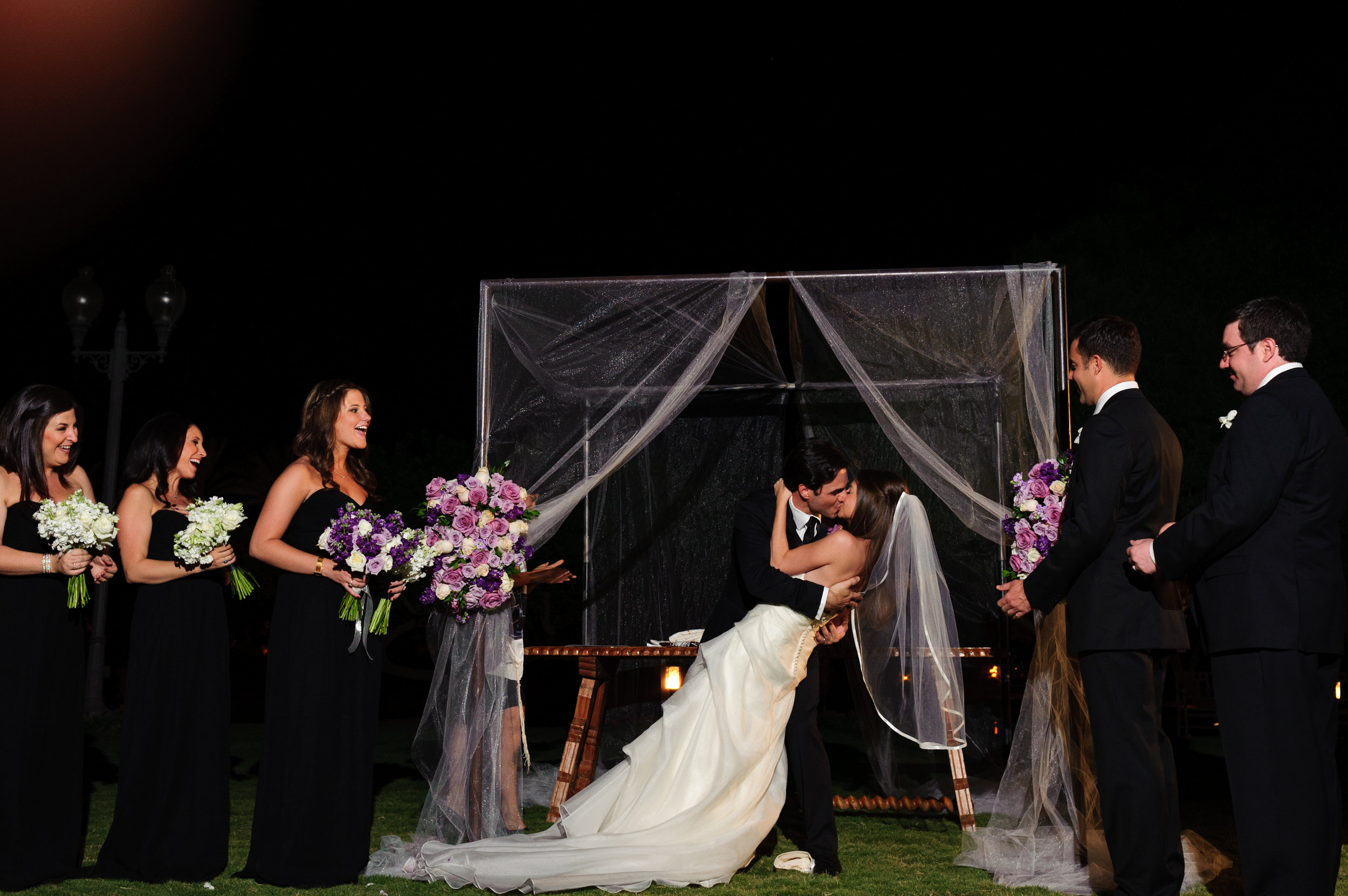 23  bride and groom at the alter evening wedding ceremony bride and groom exchanging vows first kiss Sergio Photography Life Design Events.JPG.JPG