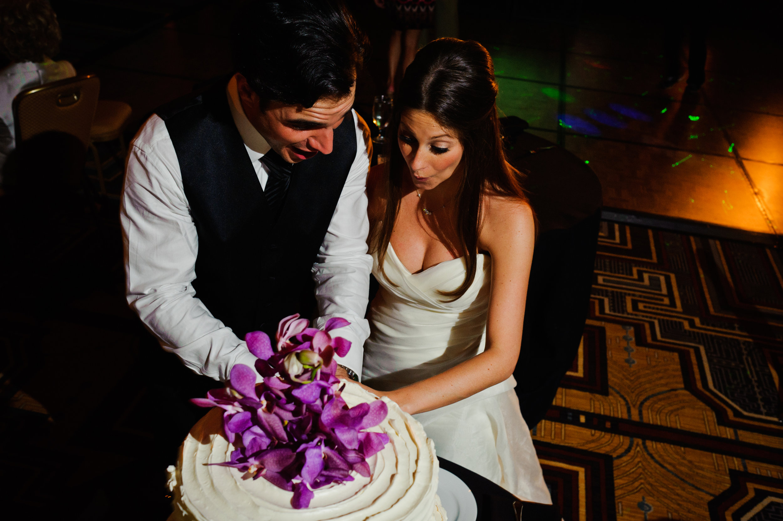 38 bride and groom cutting cake cake cutting at reception candid bride and groom photos Sergio Photography Life Design Events.JPG