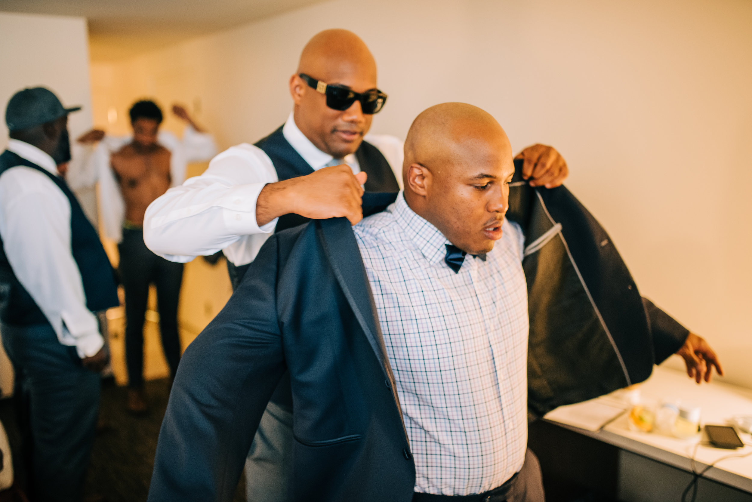 8 groom suit jacket groomsmen help groom groom getting dressed Life Design Events photos by Josh Snyder Photography.jpg