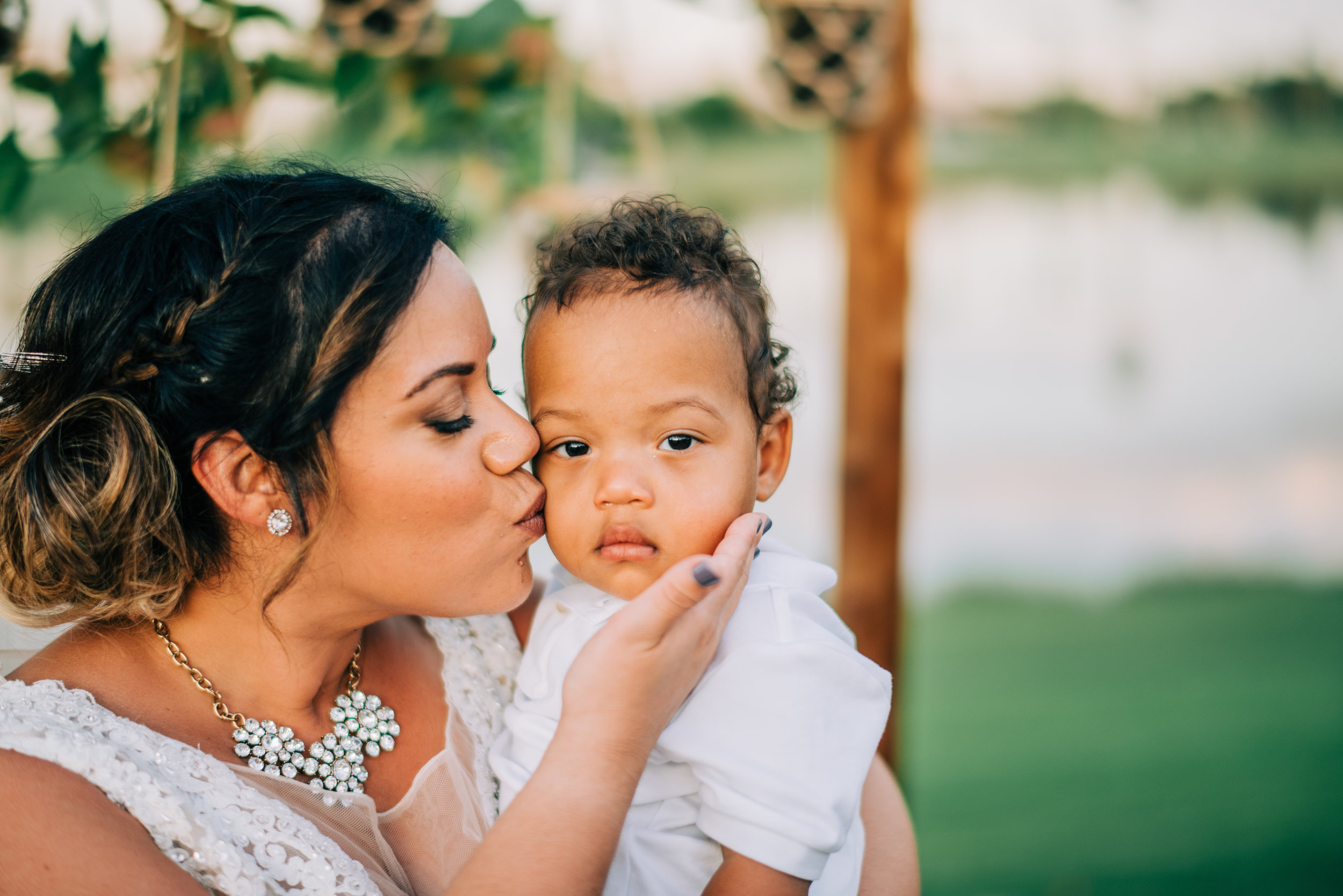 12 bride kiss son bride mom wedding couple with kids baby in wedding Life Design Events photos by Josh Snyder Photography.jpg