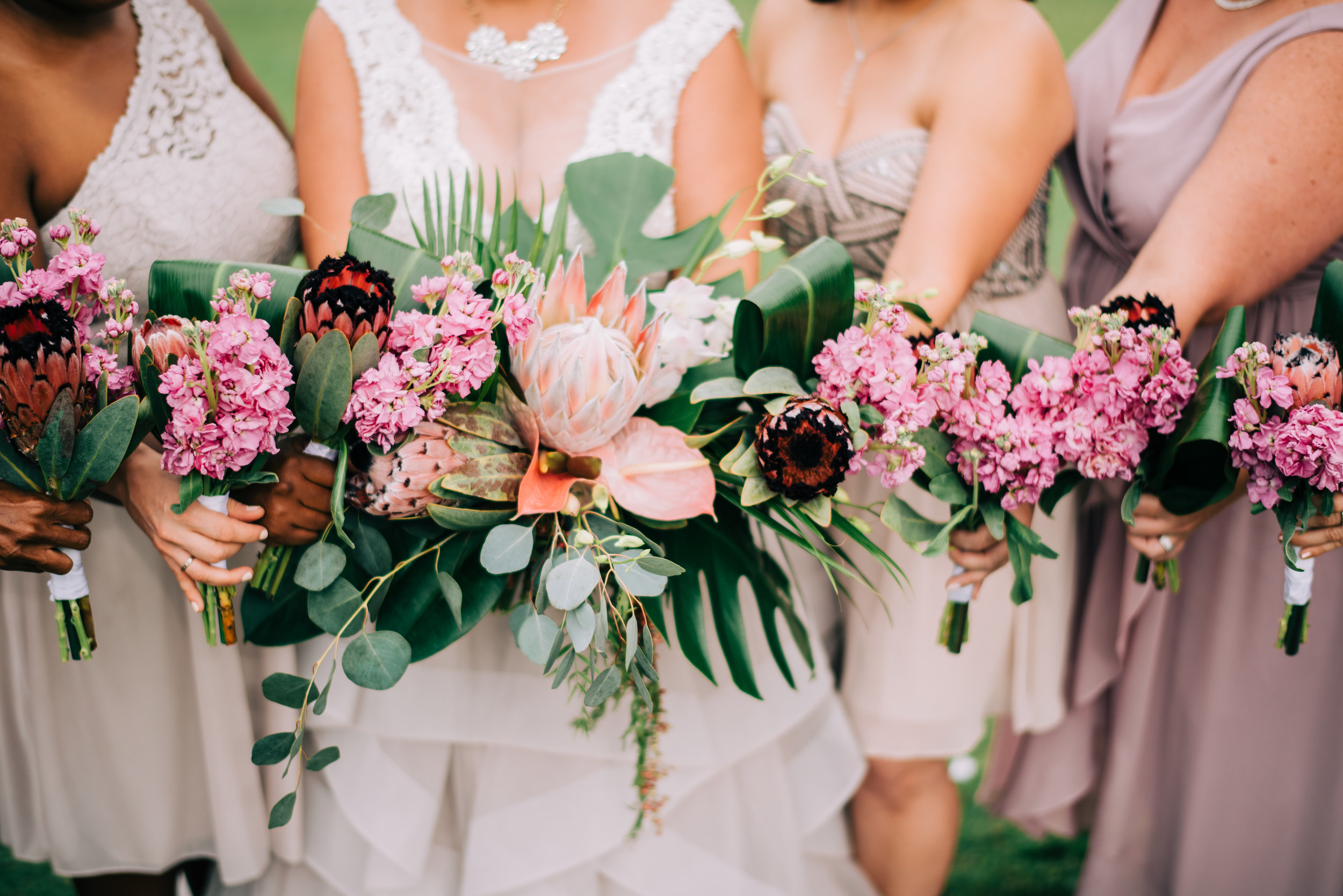 17 bride bouquet tropical flower bouquet bridesmaid bouquet shades of pink bouquet hand tied simple bouquet pink stock tropical leaves bouquet Life Design Events photos by Josh Snyder Photography.jpg