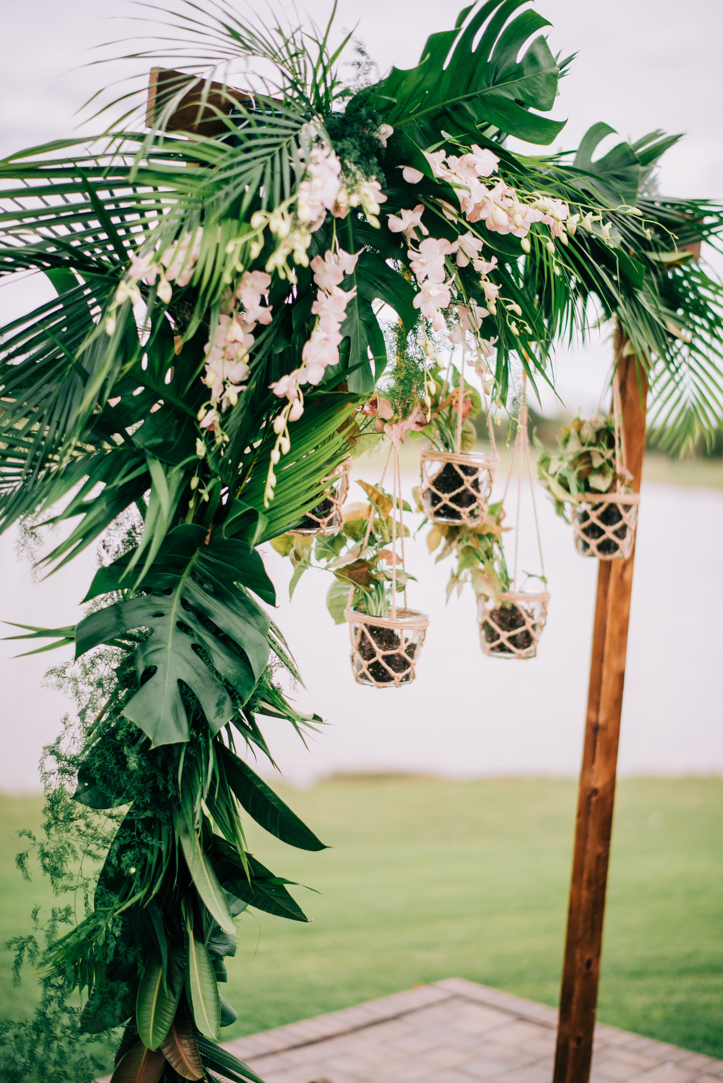 18 tropical wedding arch tropical leaves orchid arch hanging pots arch macrame flower pots Life Design Events photos by Josh Snyder Photography.jpg