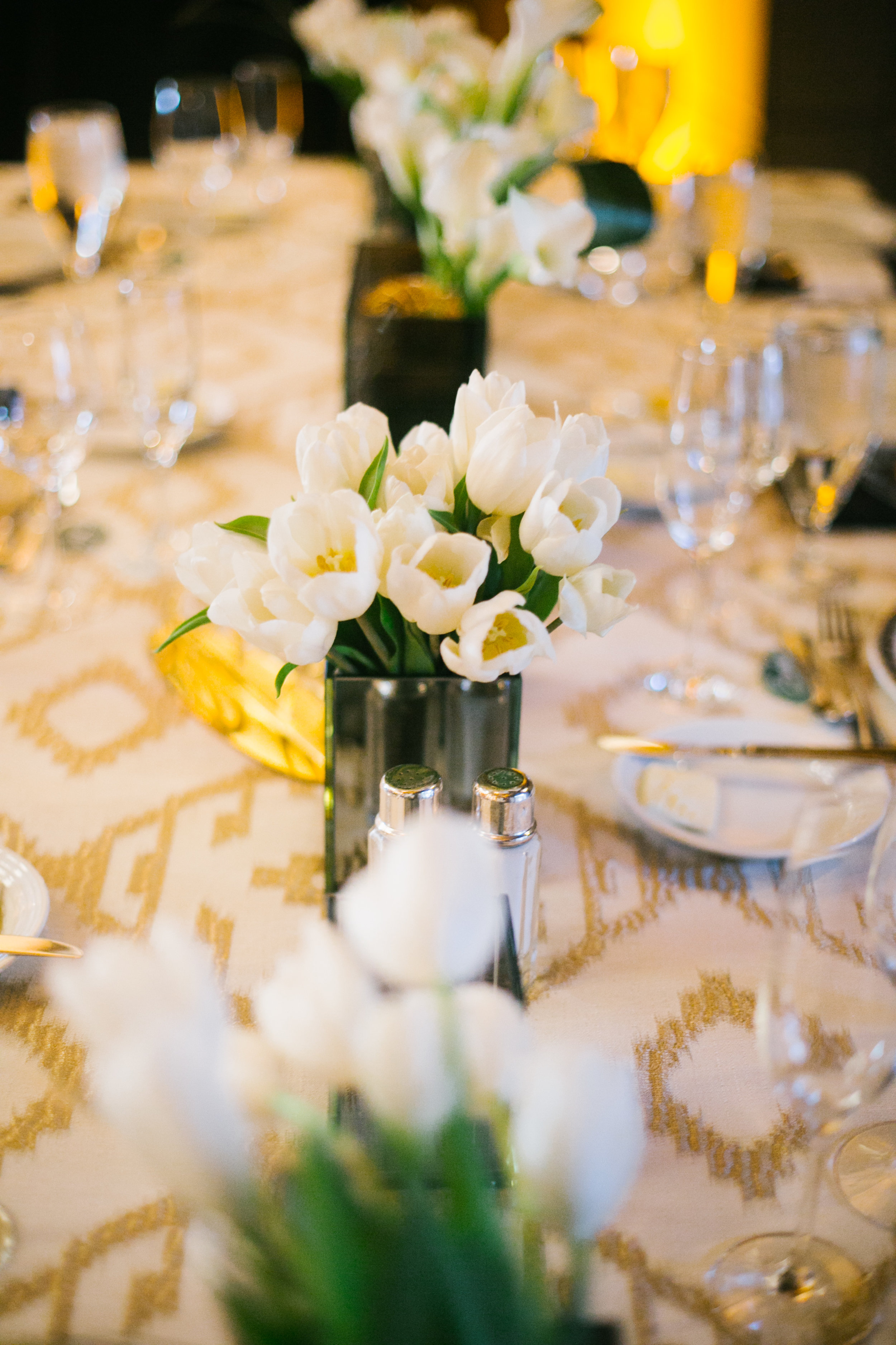 14 white tulips smoke glass vases gold geometric linen table setting simple centerpiece reception dinner table Life Design Events photos by Keith and Melissa Photography.jpg