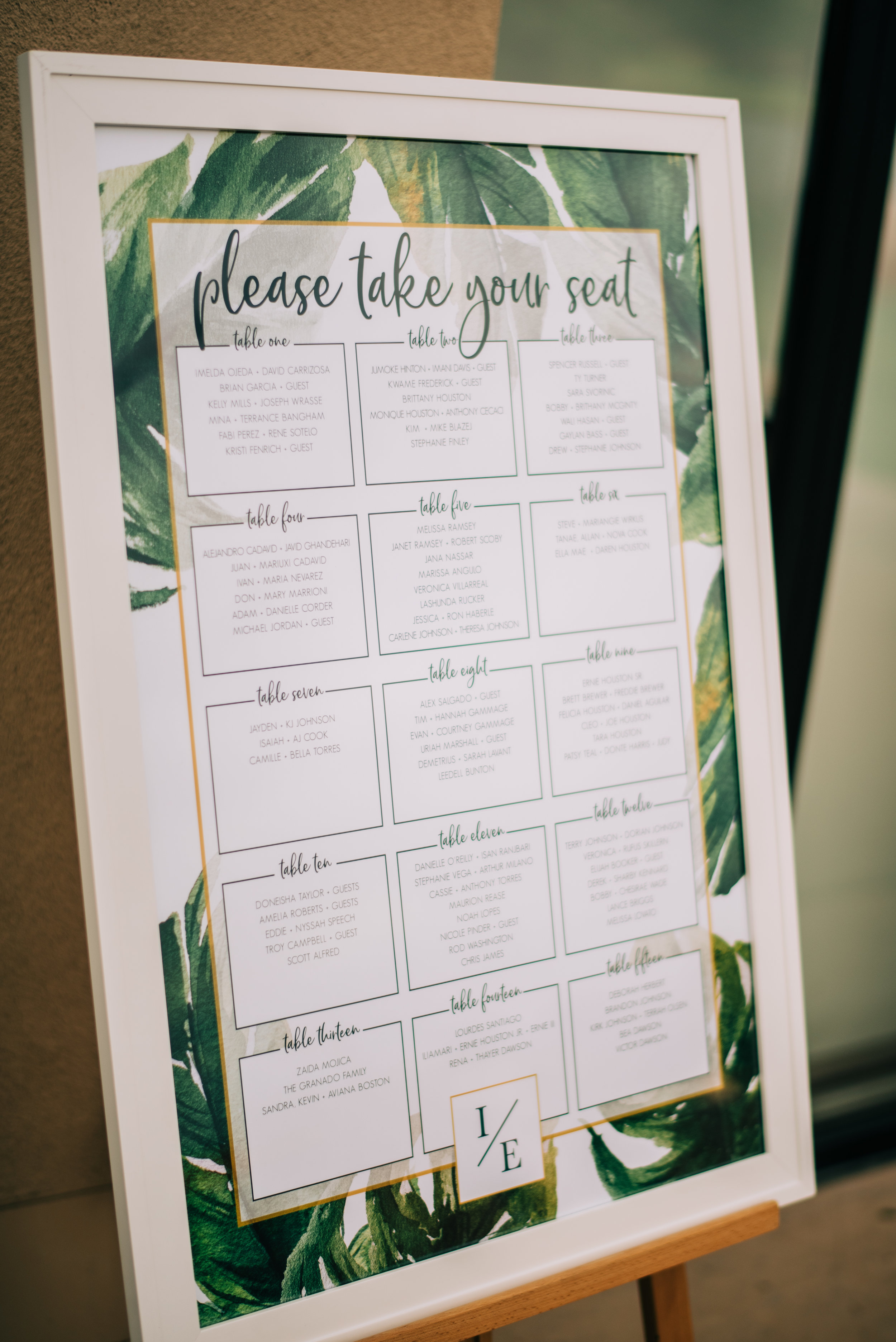 23 escort card display tropical theme wedding assigned reception seating place card escort card poster wedding guest tables Life Design Events photos by Josh Snyder Photography.jpg