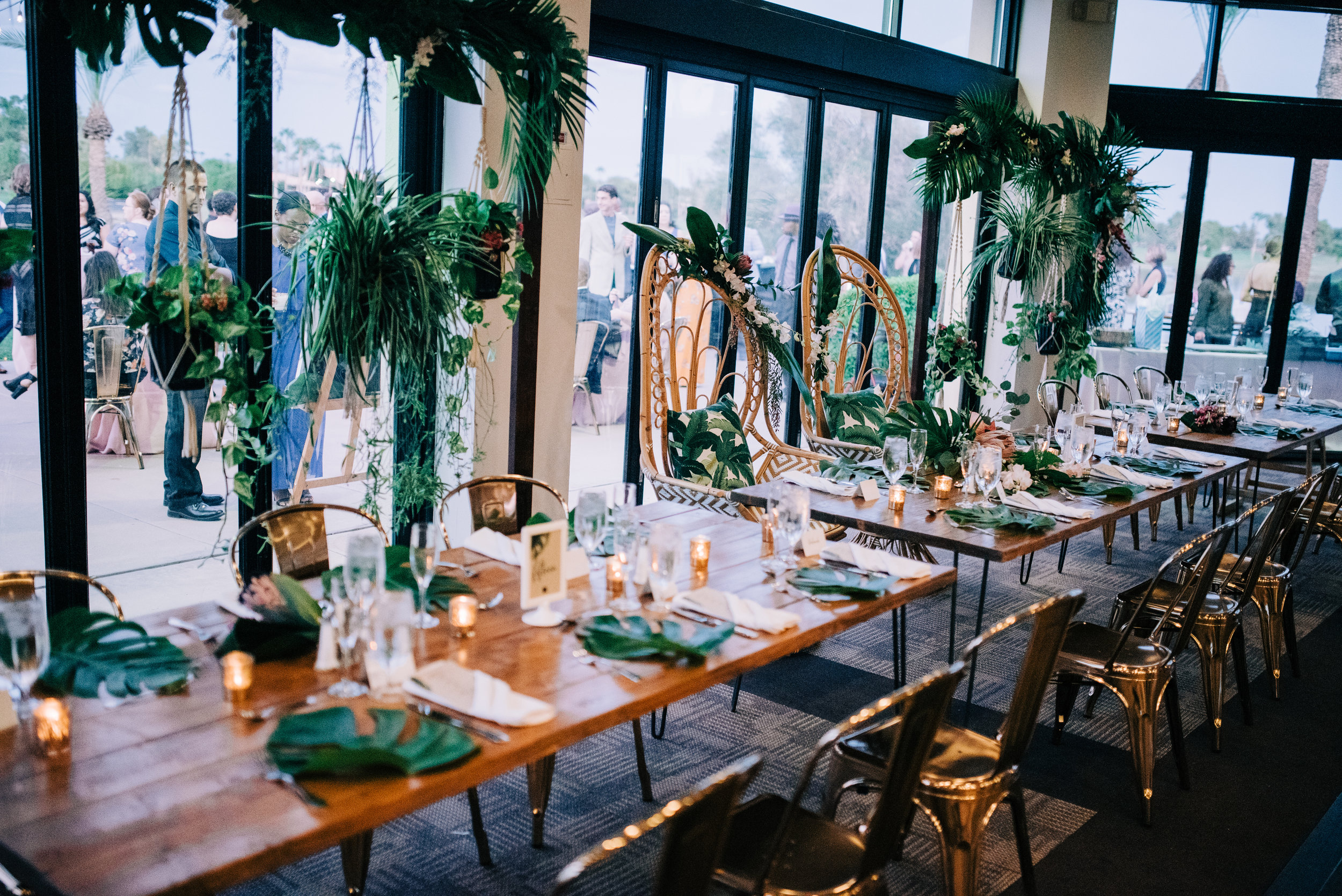 25 wedding reception head table tropical theme wedding tropical leaf arch floral arch candlelight dinner Life Design Events photos by Josh Snyder Photography.jpg