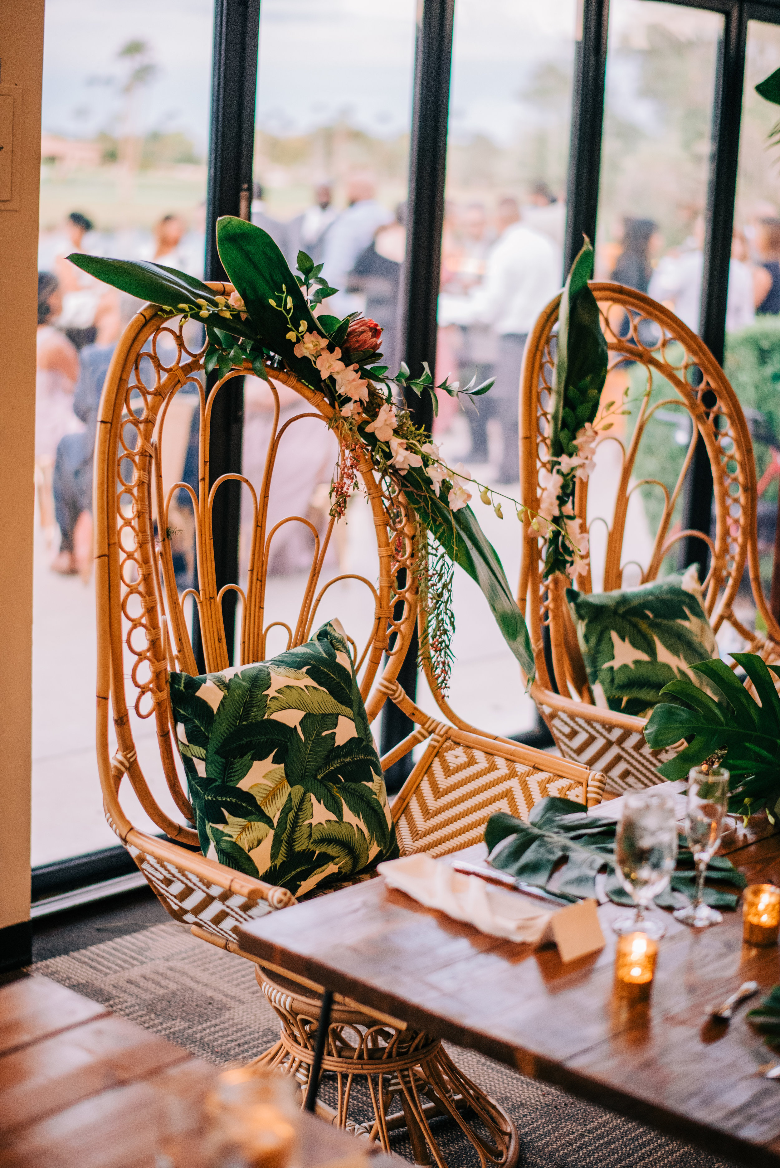 26 bride groom reception seating custom bride groom chairs tropical theme furniture wedding reception flowers on wedding chair Life Design Events photos by Josh Snyder Photography.jpg
