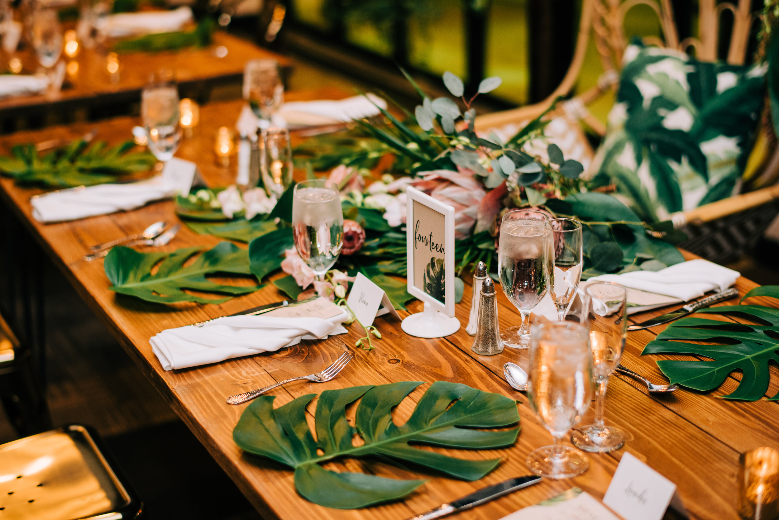 28 tropical leaf placemat tropical theme wedding reception place setting head table seating wedding reception Life Design Events photos by Josh Snyder Photography.jpg