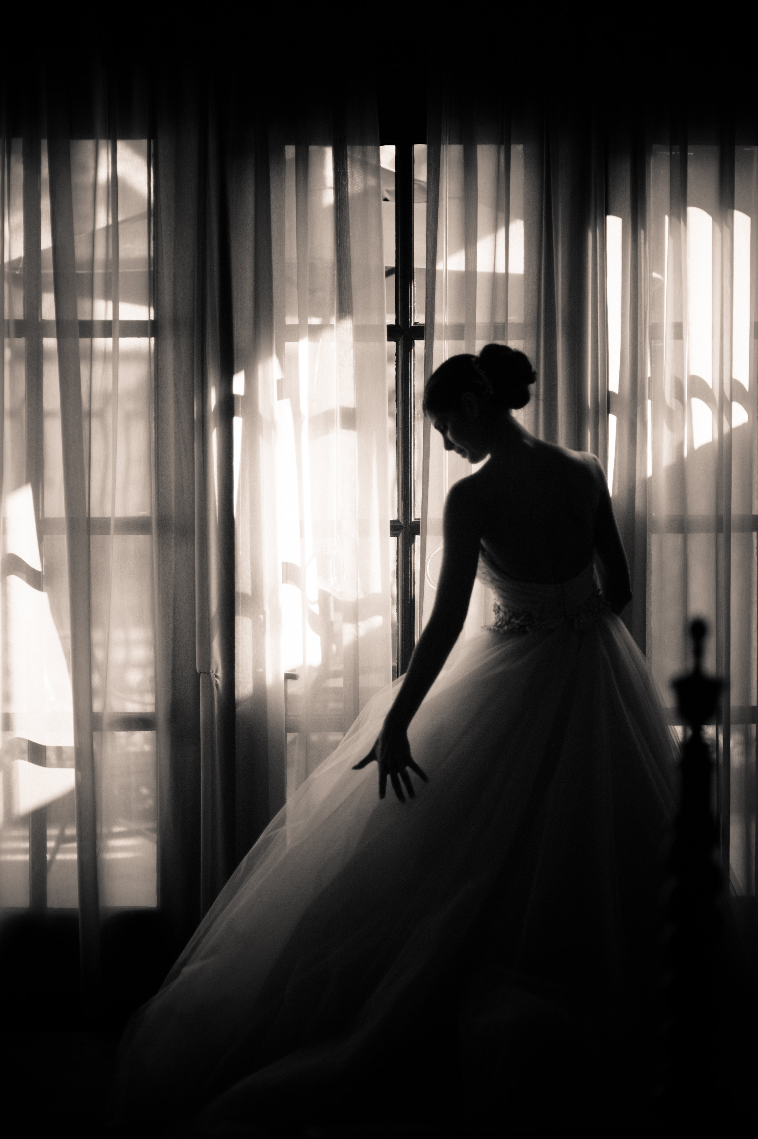 4 bride getting ready bride putting on dress mother of bride buttoning brides dress classic bride getting into dress photos Christine Johnson Photography Life Design Events .jpg