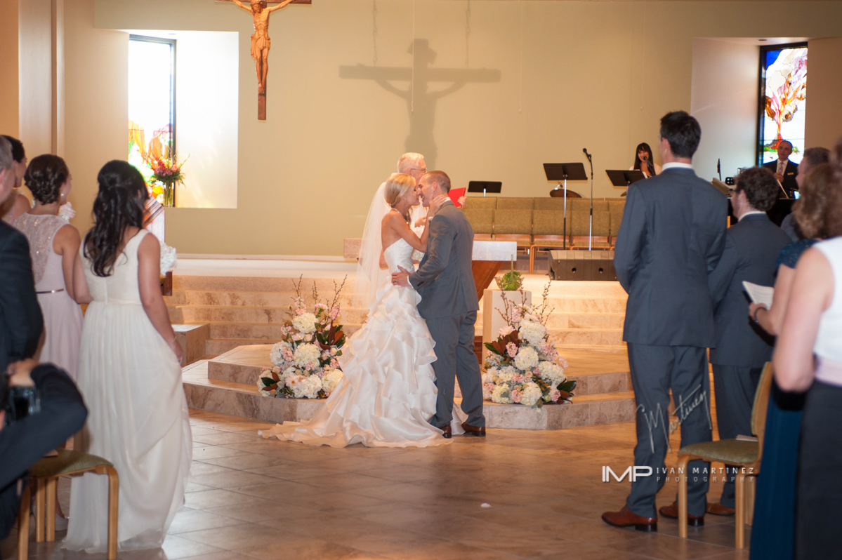 4 church ceremony small ceremony simple ceremony bride and groom first kiss Ivan Martinez photography Life Design Events.JPG