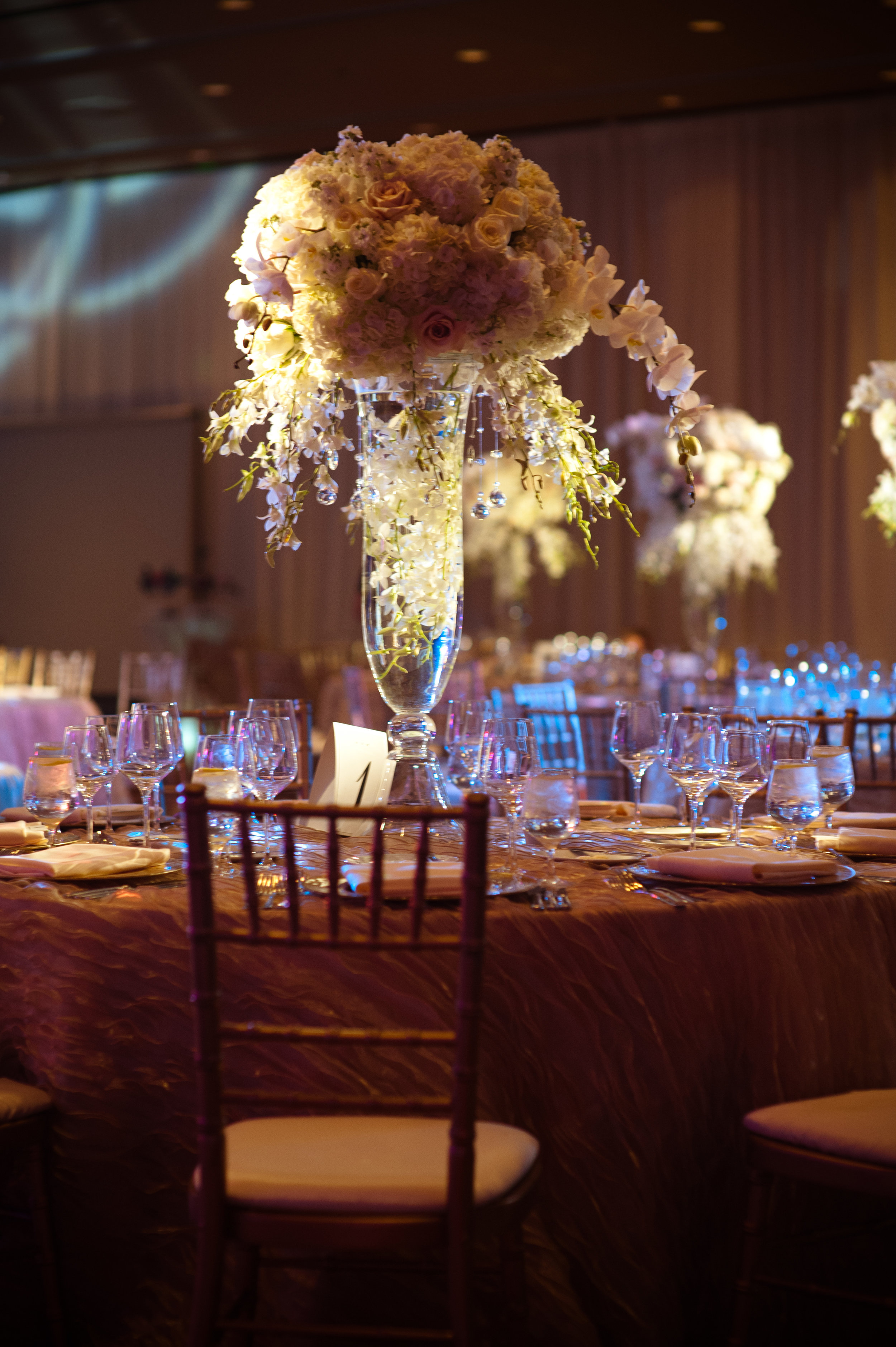 22 tall centerpieces purple and white centerpieces unique centerpieces elegant centerpieces fancy centerpieces Christine Johnson Photography Life Design Events .jpg