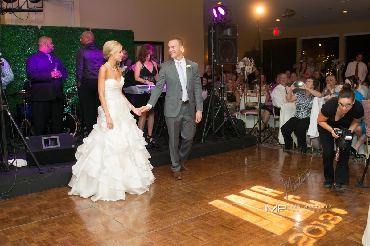 11 bride and groom first dance bride and groom on the dance floor indoor wedding reception indoor wedding dance floor Ivan Martinez Photography Life design Events .JPG