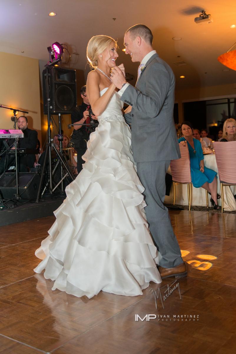 12 bride and groom first dance bride and groom on the dance floor indoor wedding reception indoor wedding dance floor Ivan Martinez Photography Life design Events .JPG.JPG