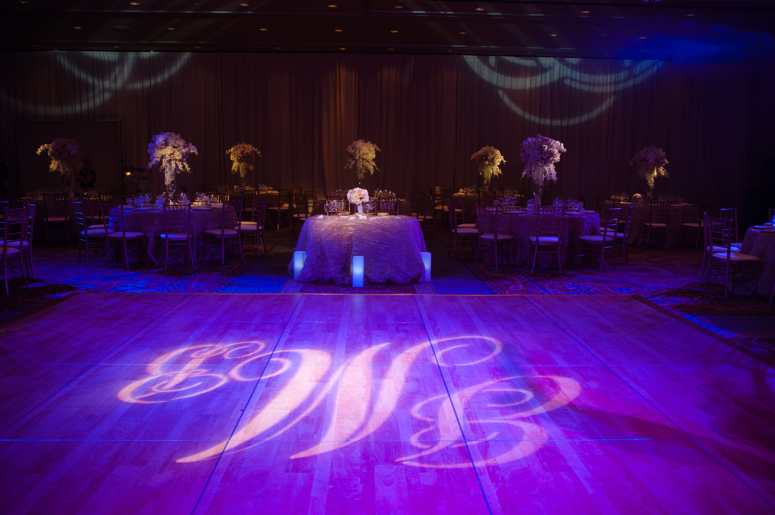 27 reception hall last name initial on the dance floor sweetheart table in the center Christine Johnson Photography Life Design Events.jpg