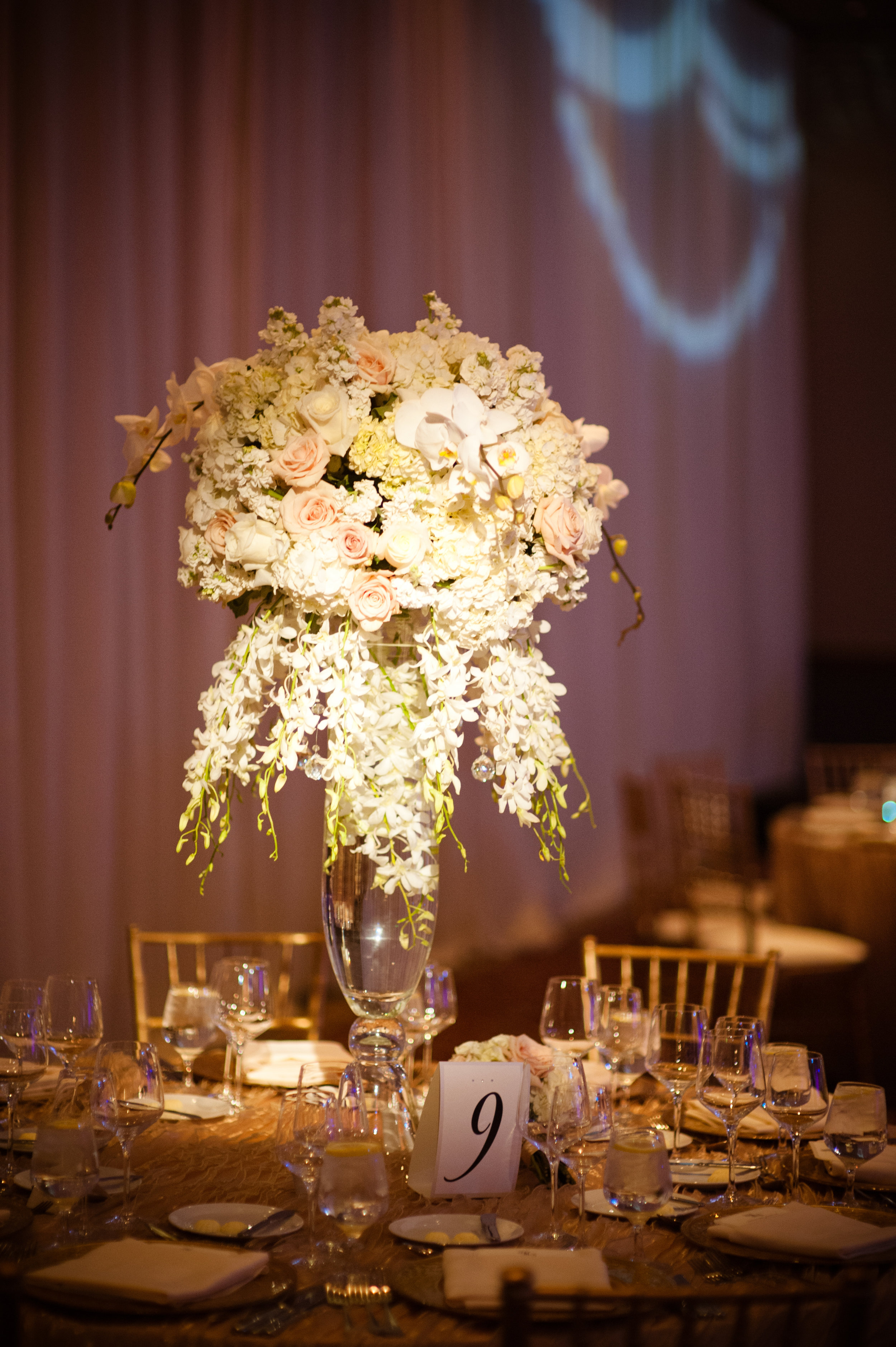 32 tall centerpieces purple and white centerpieces unique centerpieces elegant centerpieces fancy centerpieces Christine Johnson Photography Life Design Events .jpg
