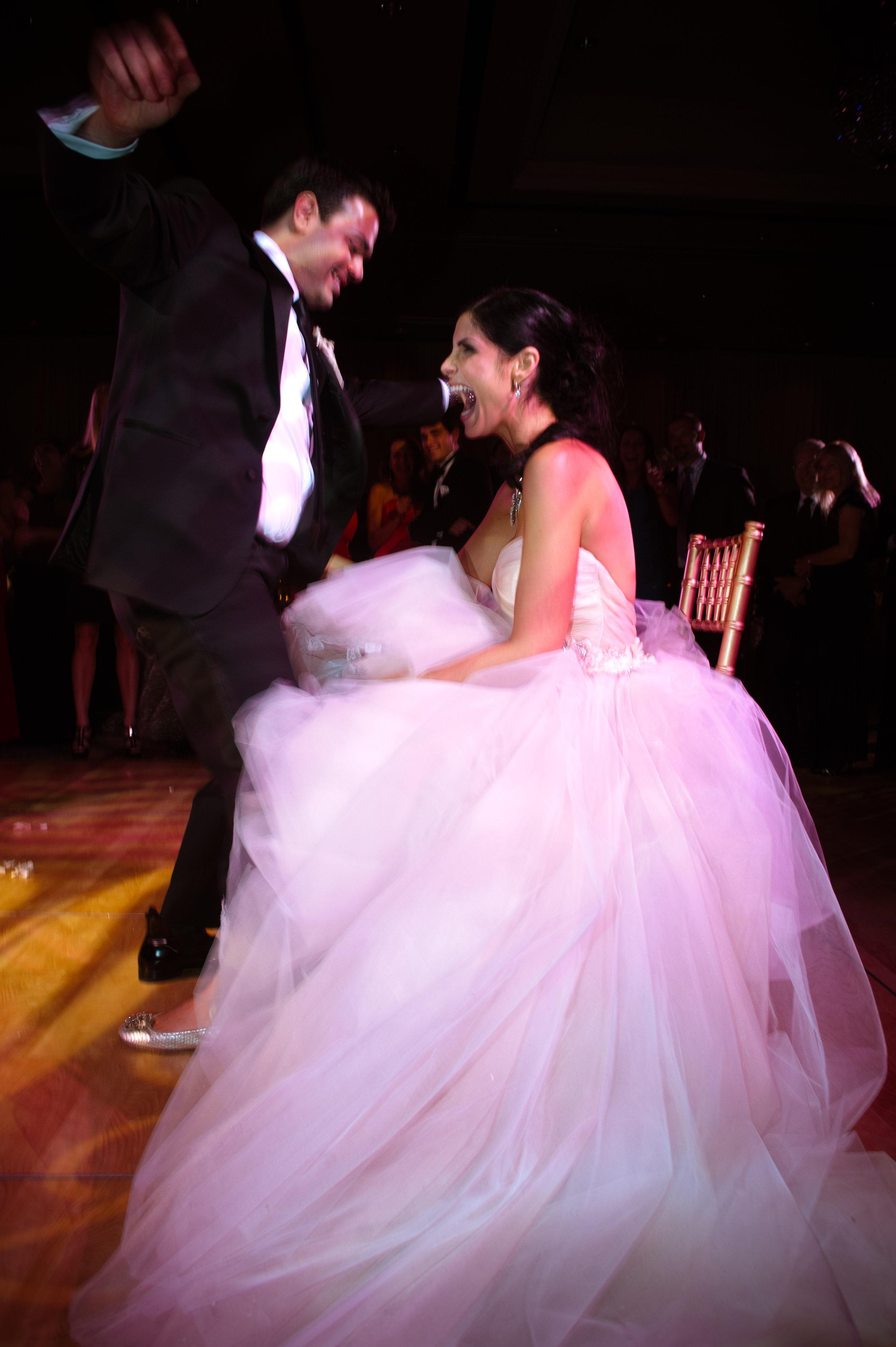 49 garter removal groom removing brides garter traditional wedding Christine Johnson Photography Life Design Events.jpg