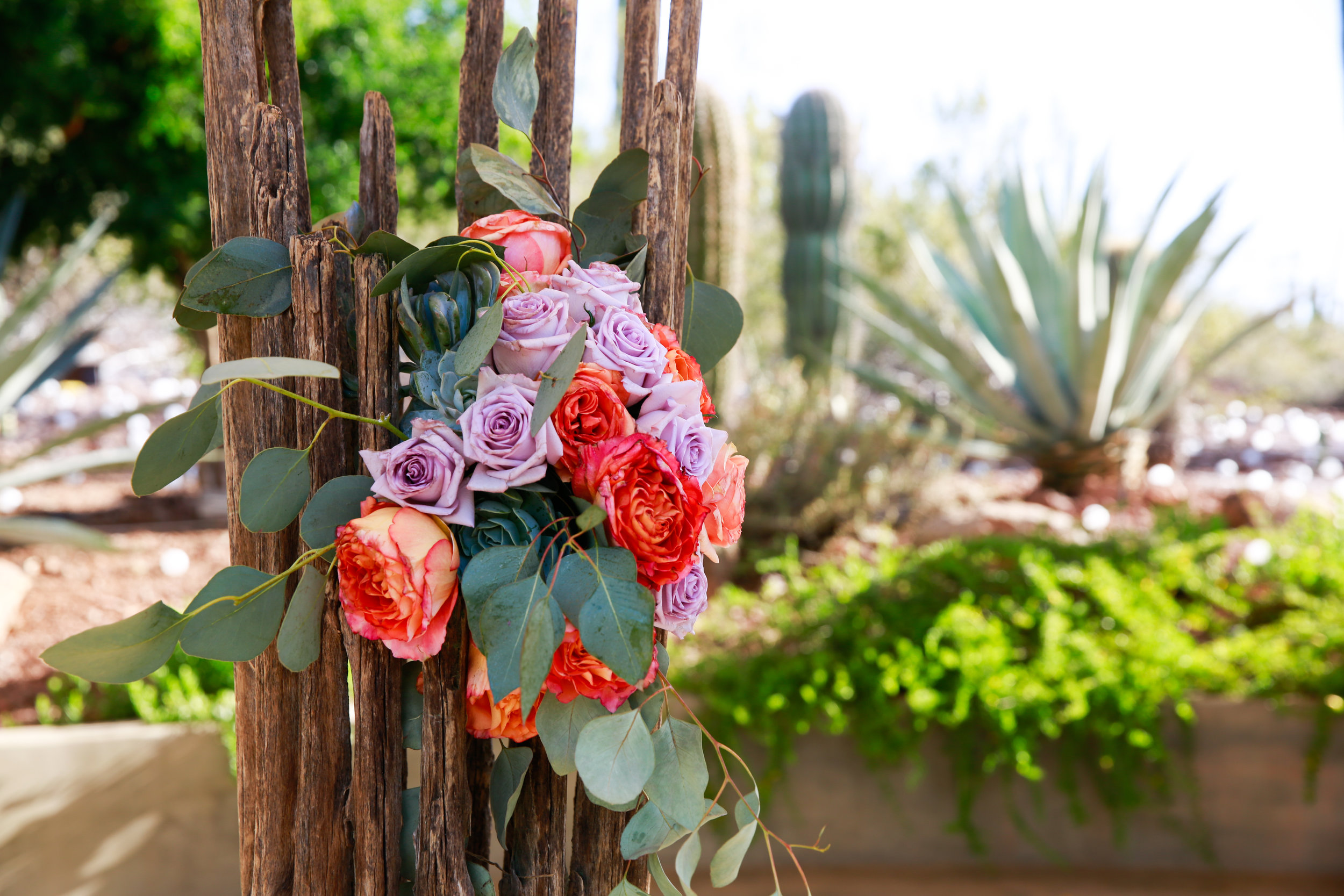 3 wedding florals red and purple roses eucalyptus with floral arrangements Mod Wed Photography Life Design Events .jpg