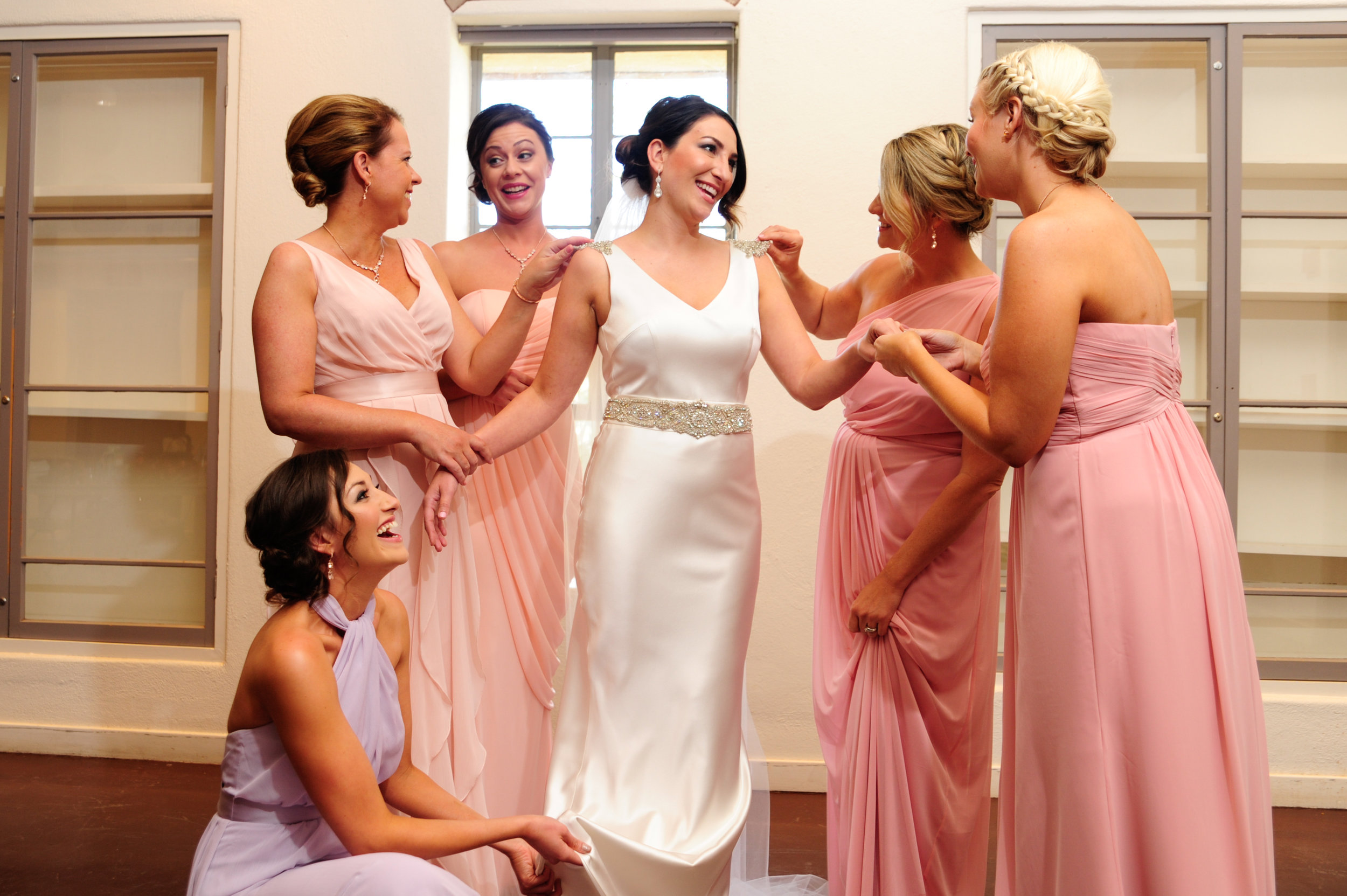 5 getting ready photos bride putting on her dress photos bride and brides maid getting ready photos Mod Wed Photography Life Design Events.jpg