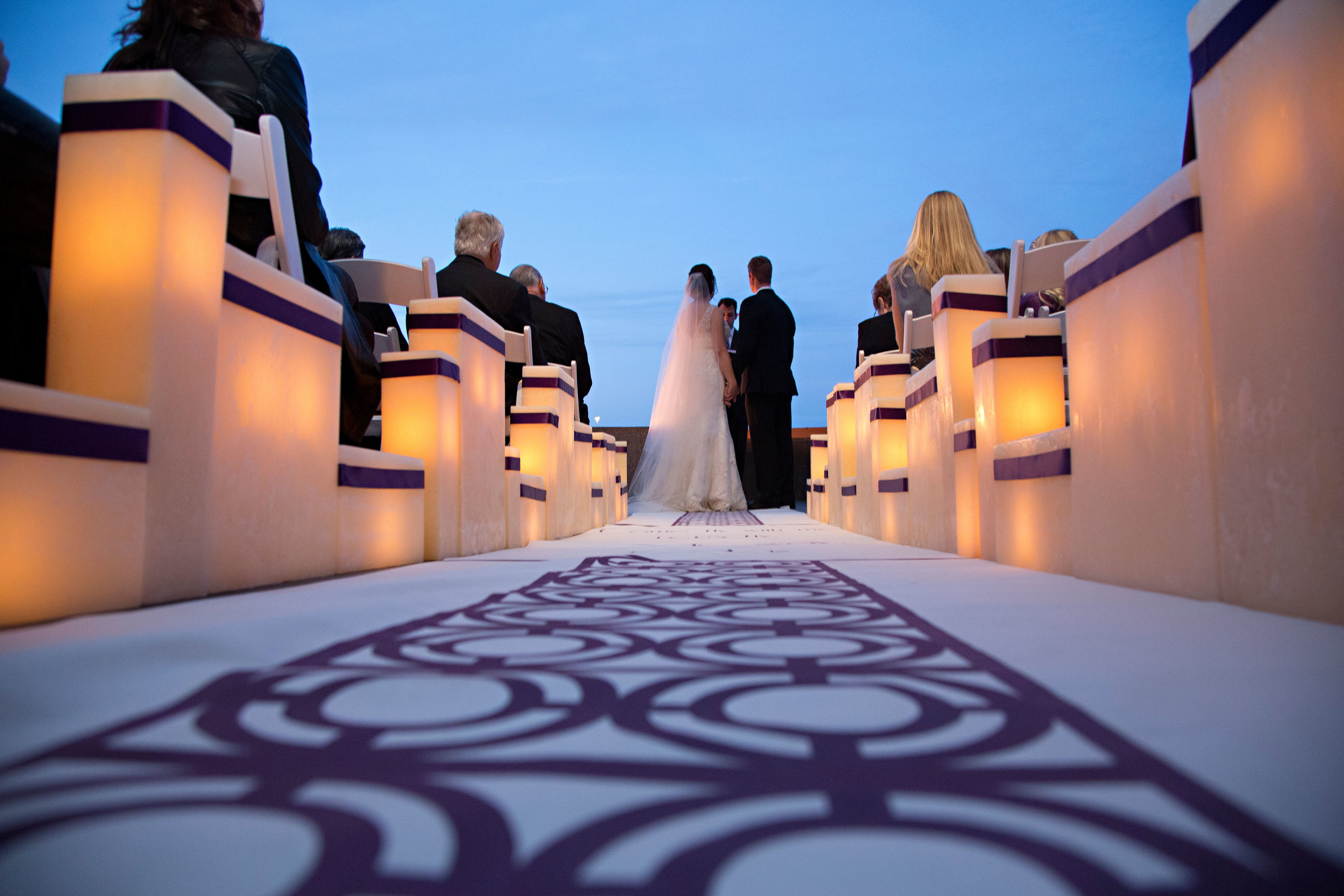 14 bride and groom at ceremony ceremony at dusk bride and groom exchanging vows O Grace Photography Life Design Events.jpg