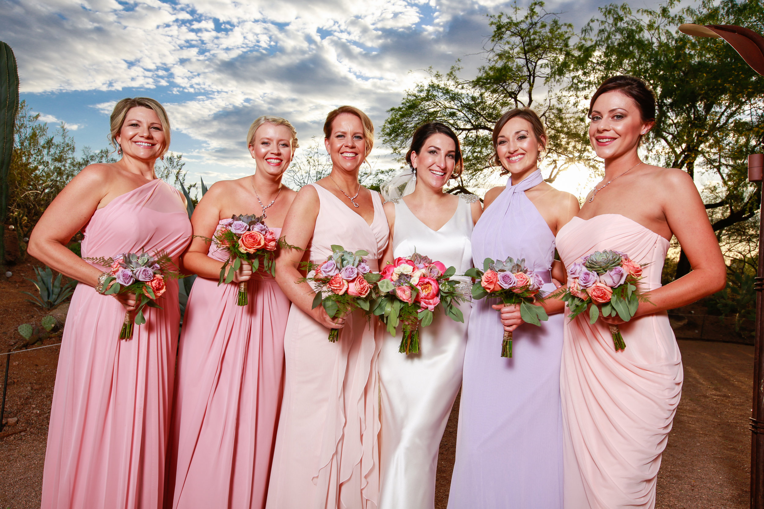 22 bride with bridesmaids simple bridesmaid dresses elegant bridesmaid dresses pink bridesmaid dresses purple and pink rose bouquets Mod Wed Photography Life Design Events.jpg
